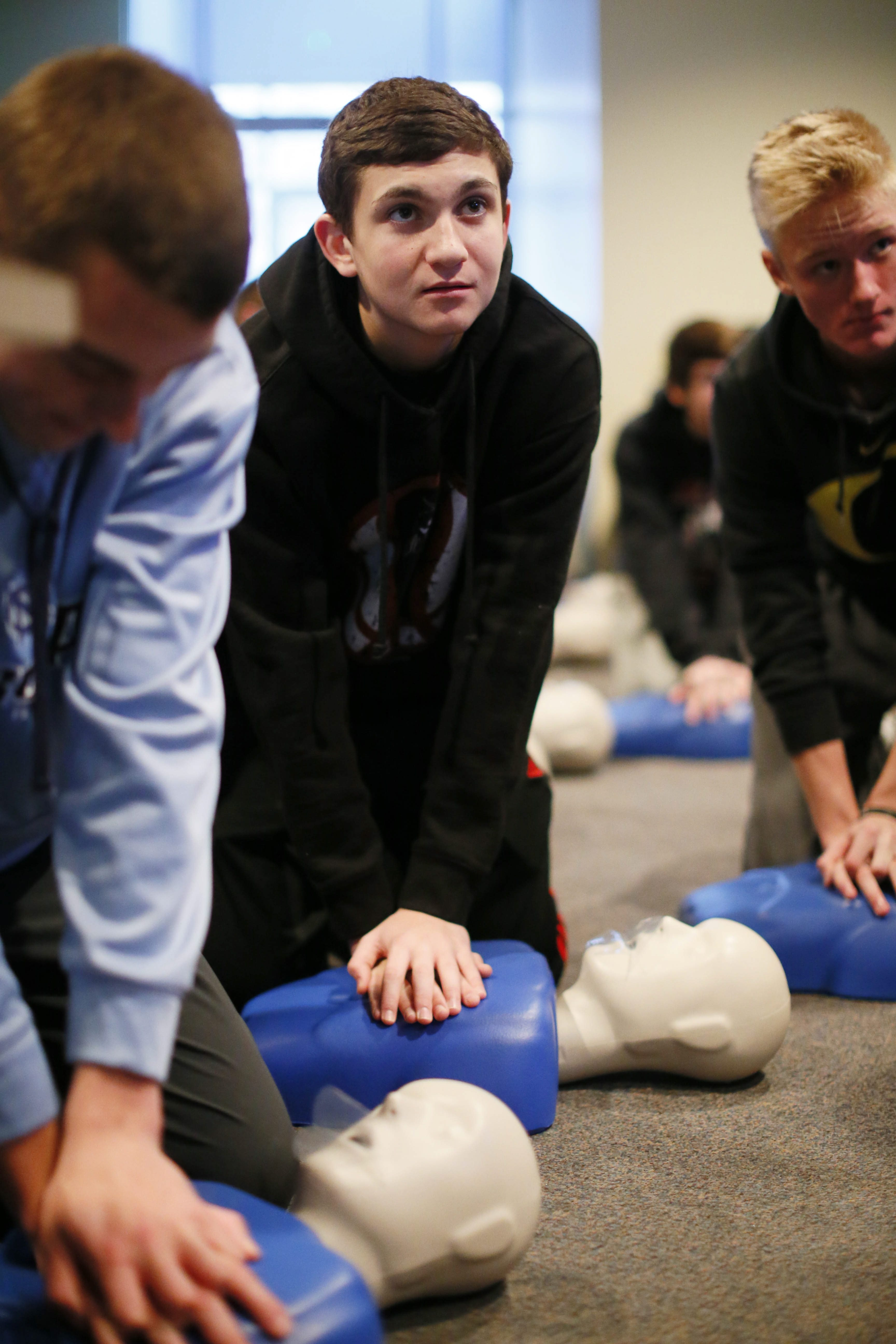 JJ Pesany, 15, center, practices CPR during a class Friday at Twin District Vol. Fire Company.