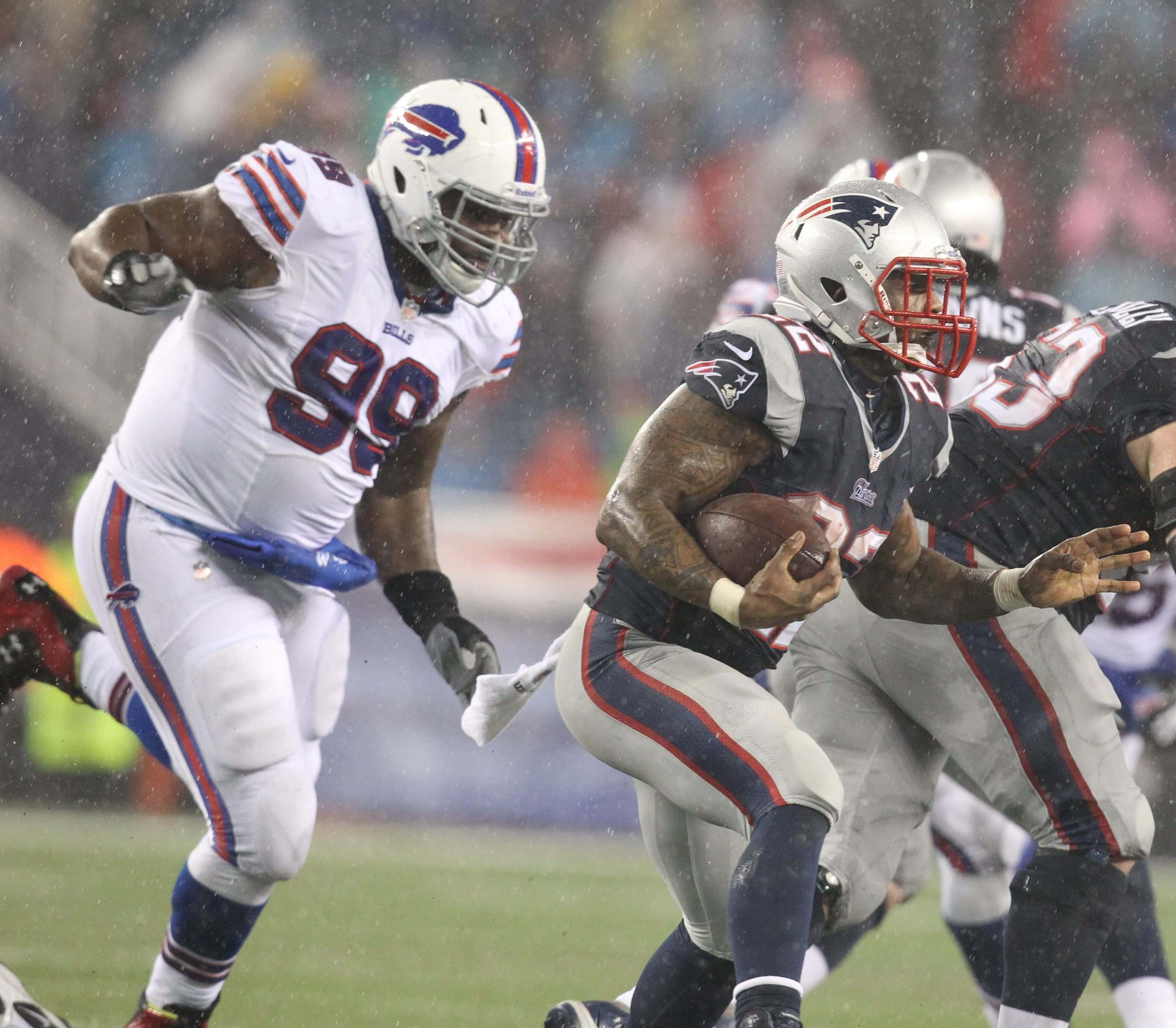 Bills defensive tackle Marcell Dareus trails Patriots running back Stevan Ridley on a third-quarter running play.