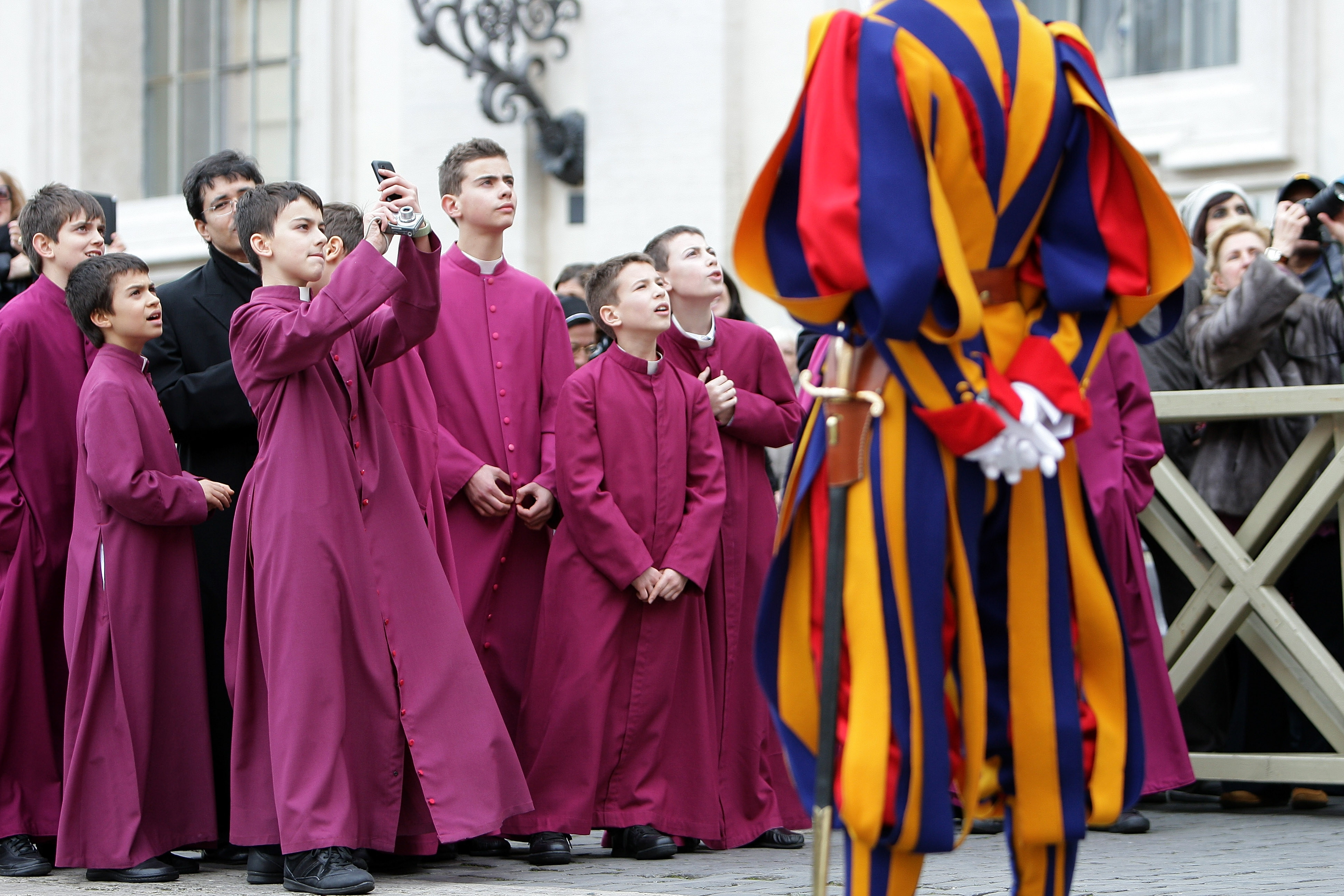 Altar boys gather in St. Peter's Square to attend Pope Francis' Christmas Day message, which focused on a broad call for global peace.