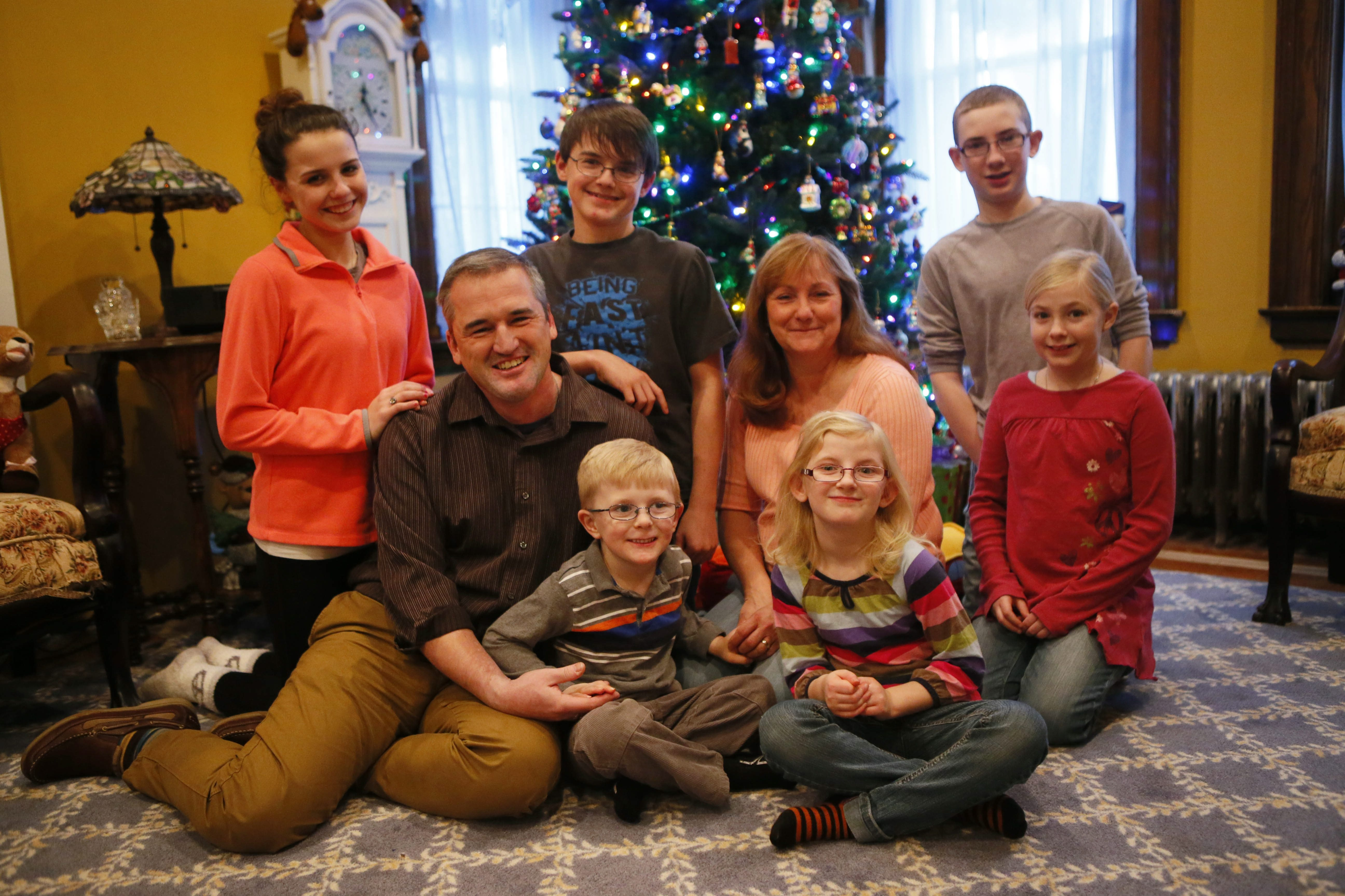 Michael and Elizabeth Sobaszek celebrate with their children Monday.  The kids are, back row, from left, Gabriella, 16, Zackary, 14, and Lucas, 13; front row, from left,  Thor, 4, Annastasia, 8, and Willow, 10.