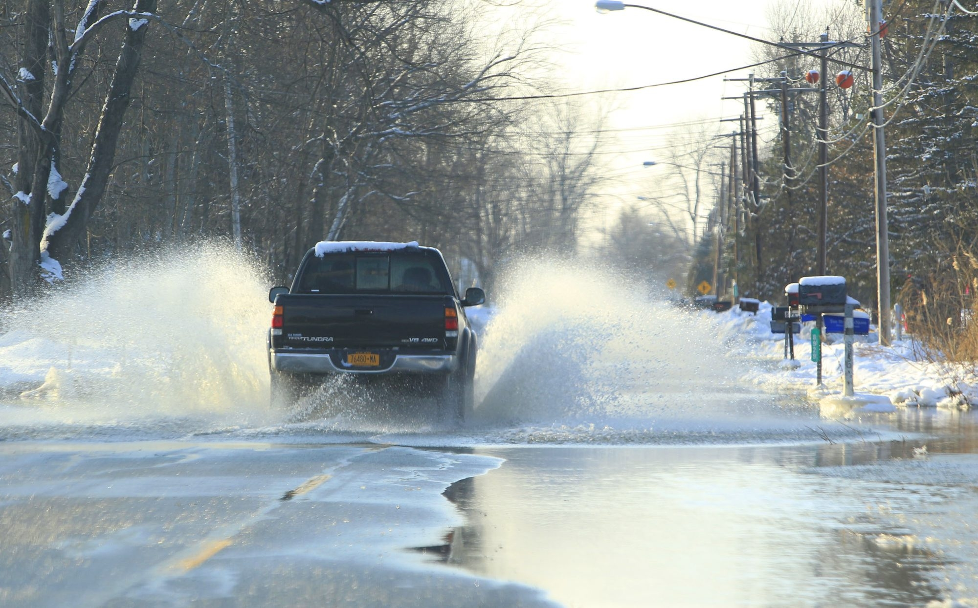 A general view of Wolcott Road in Clarence Center, where Clarence Highway Department workers prepare to reopen it Thursday.
