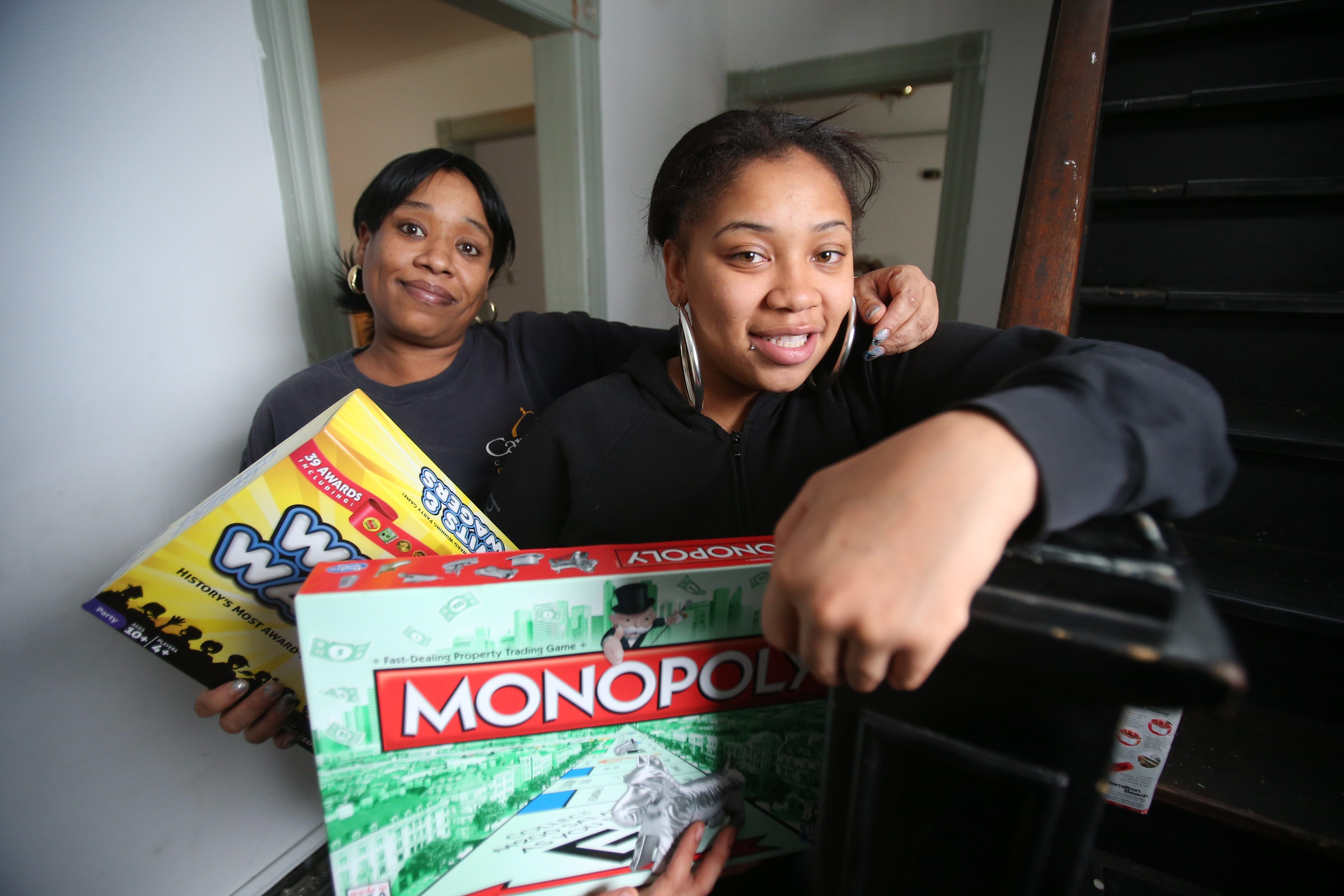 Tyra Lee, left,  and daughter Dayijiah Miller, after living in a shelter, moved into a home in early December.