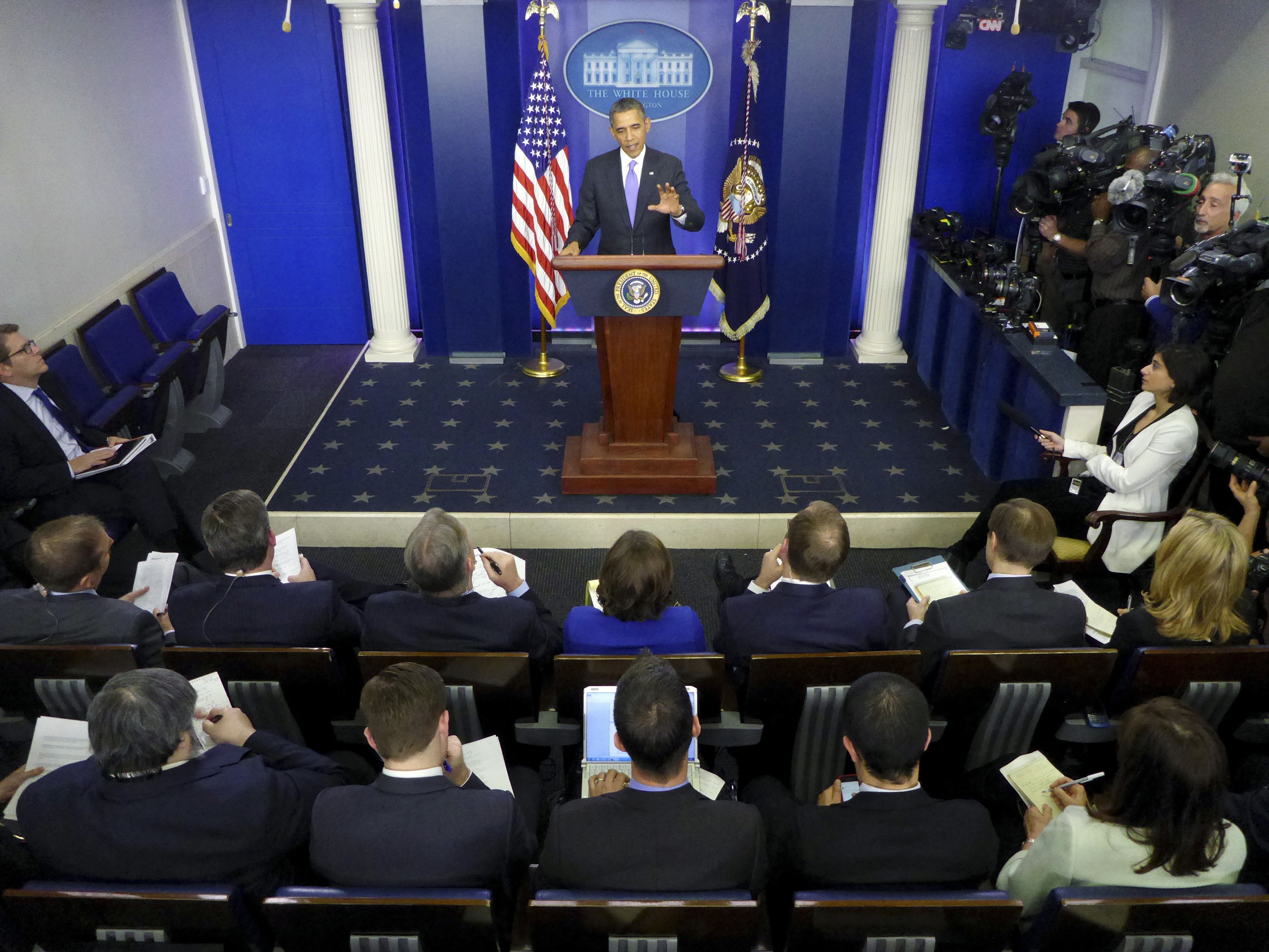 "President Obama speaks during his end-of-the-year news conference in the Brady Press Room at the White House in Washington, D.C., on Friday. The president said the coming year needs to be ""a year of action."""