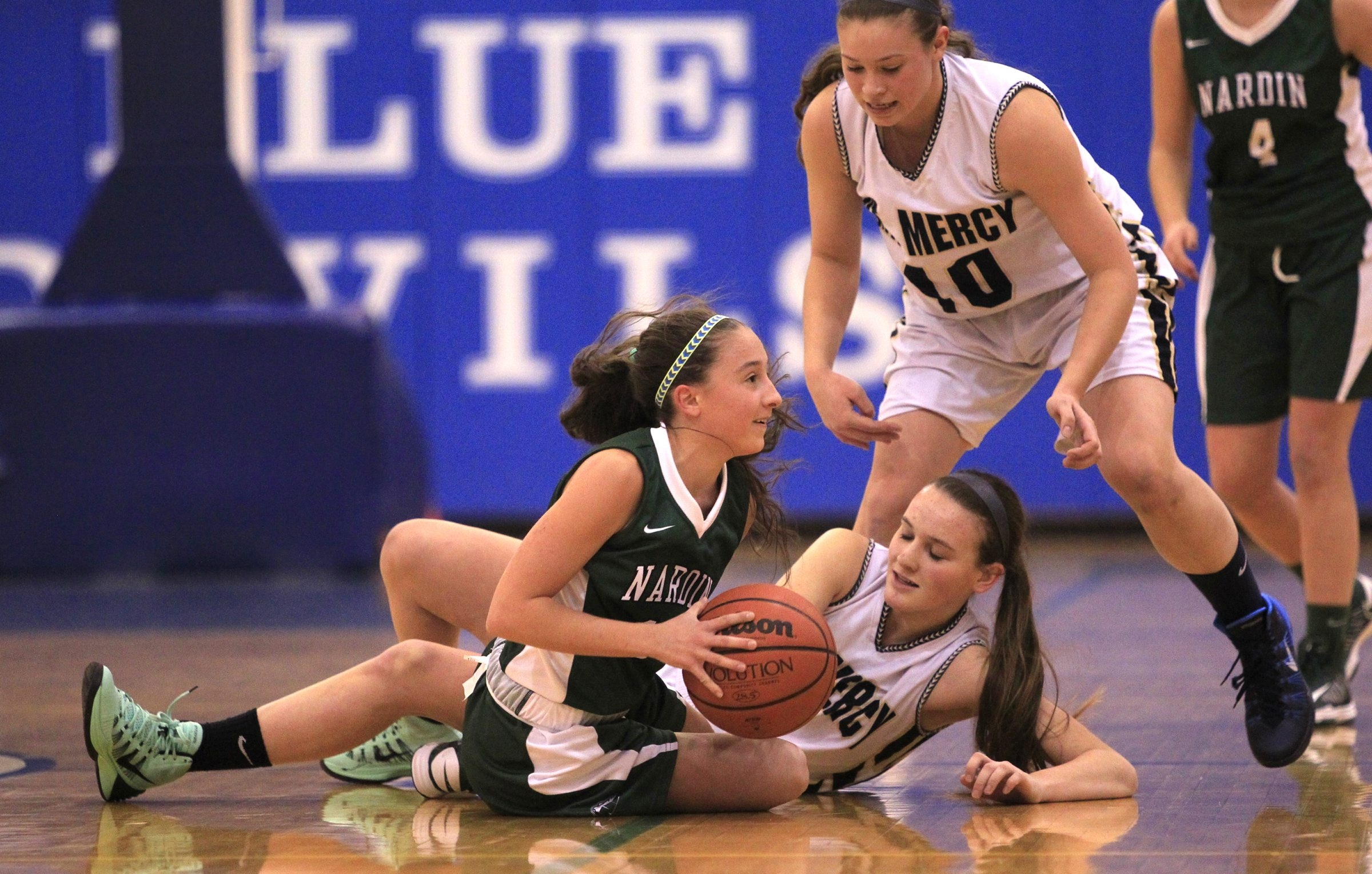 Nardin's Caroline Colpoys (13) fights for a loose ball against Mount Mercy's Emily Sheehan in the Matt Colpoys Tournament at Kenmore West High School Thursday.