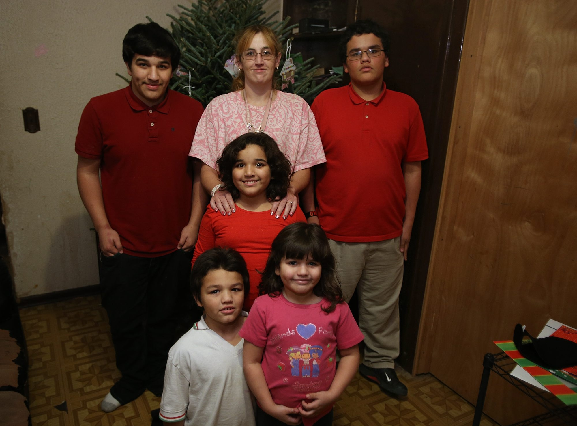 Sara Chance and her children, from left, Daniel, Dylan, Julianna, Leilani and Dominick, relocated to the West Side after being evicted.