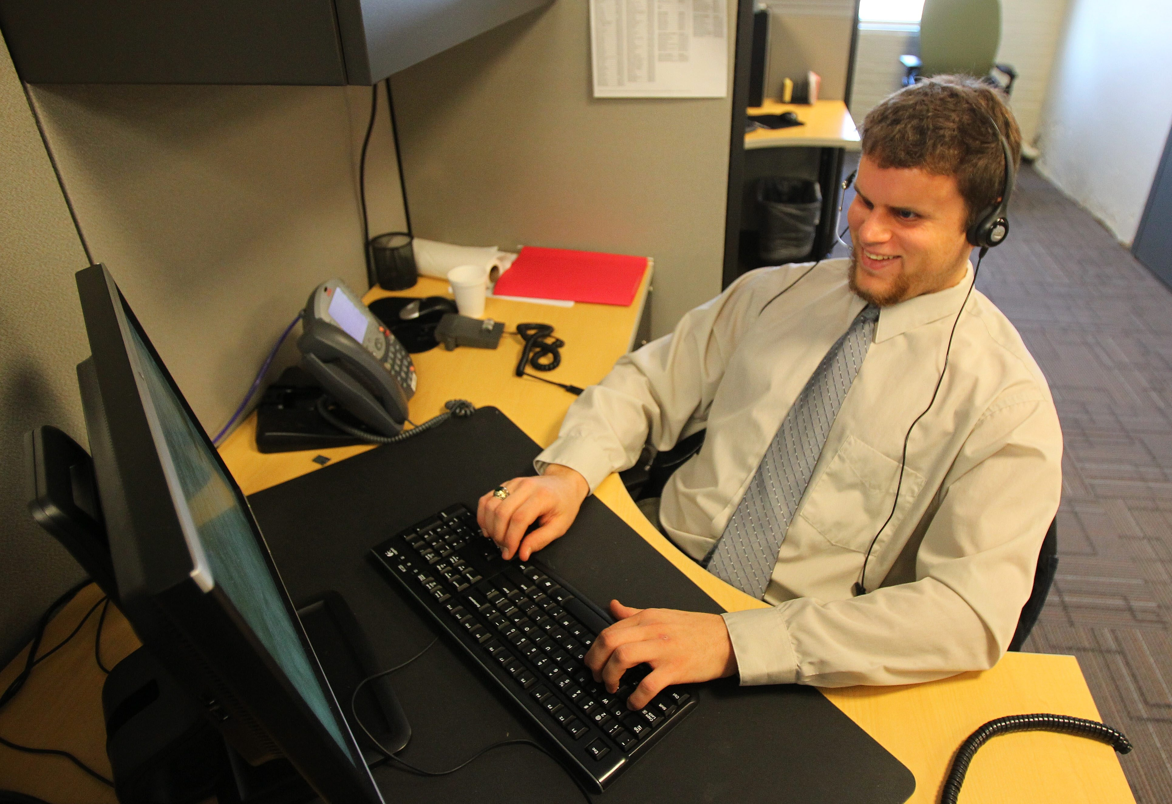 Ray Zylinski, a newcomer to the Olmsted call center, notices an increase in the number of holiday calls.