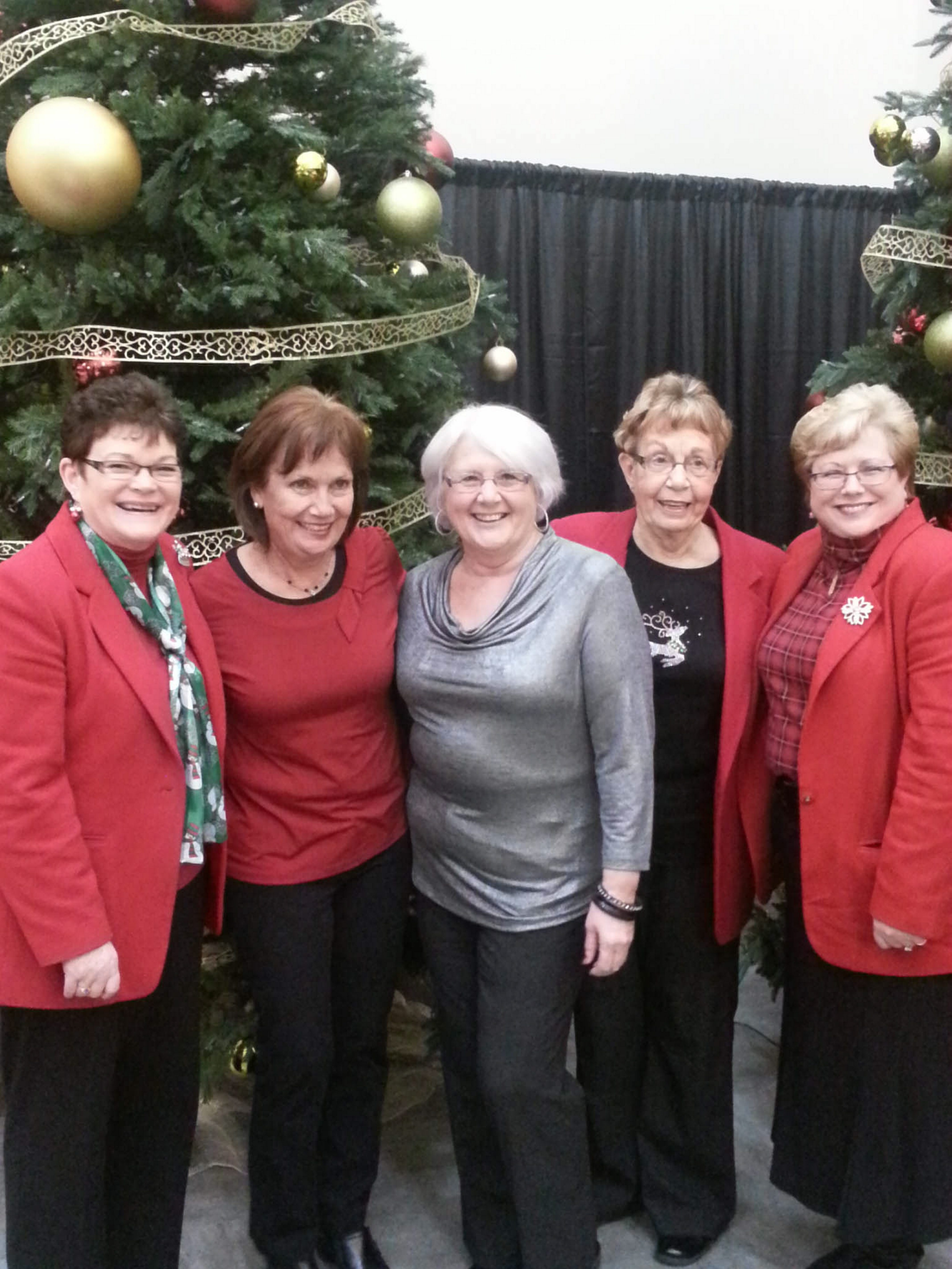 Retiring clerks Becky Connolly, of Somerset, left; Gail Zachary, of Porter, second from left; and Carol Brandon, of Lewiston, second from right; pose for a holiday picture with Kathie Smith, center, and Marie Little, right.