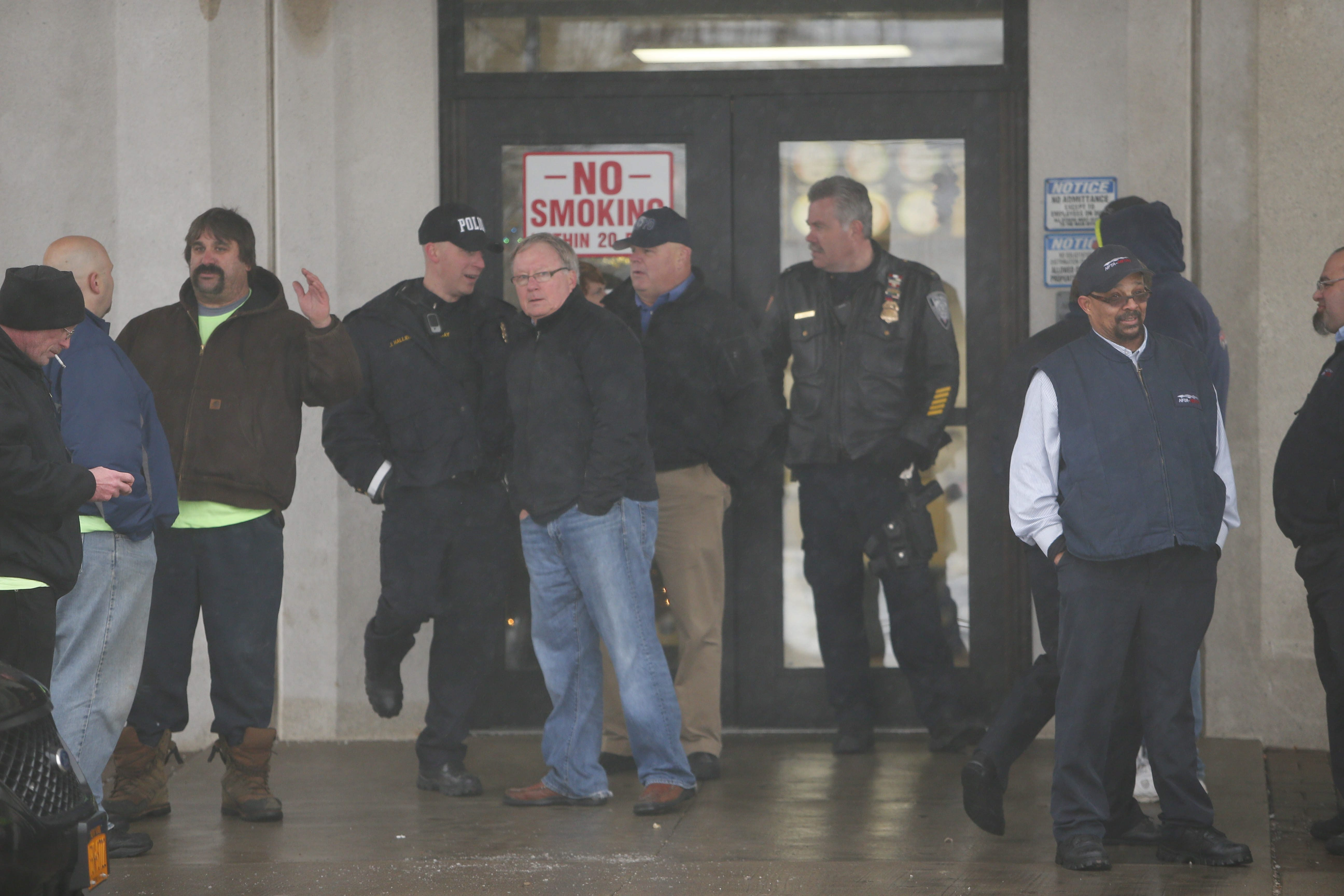 NFTA board member and Amalgamated Transit Union President Vincent G. Crehan, second from left, was prevented by NFTA police from entering the NFTA facility where the agency's holiday party was taking place Friday.