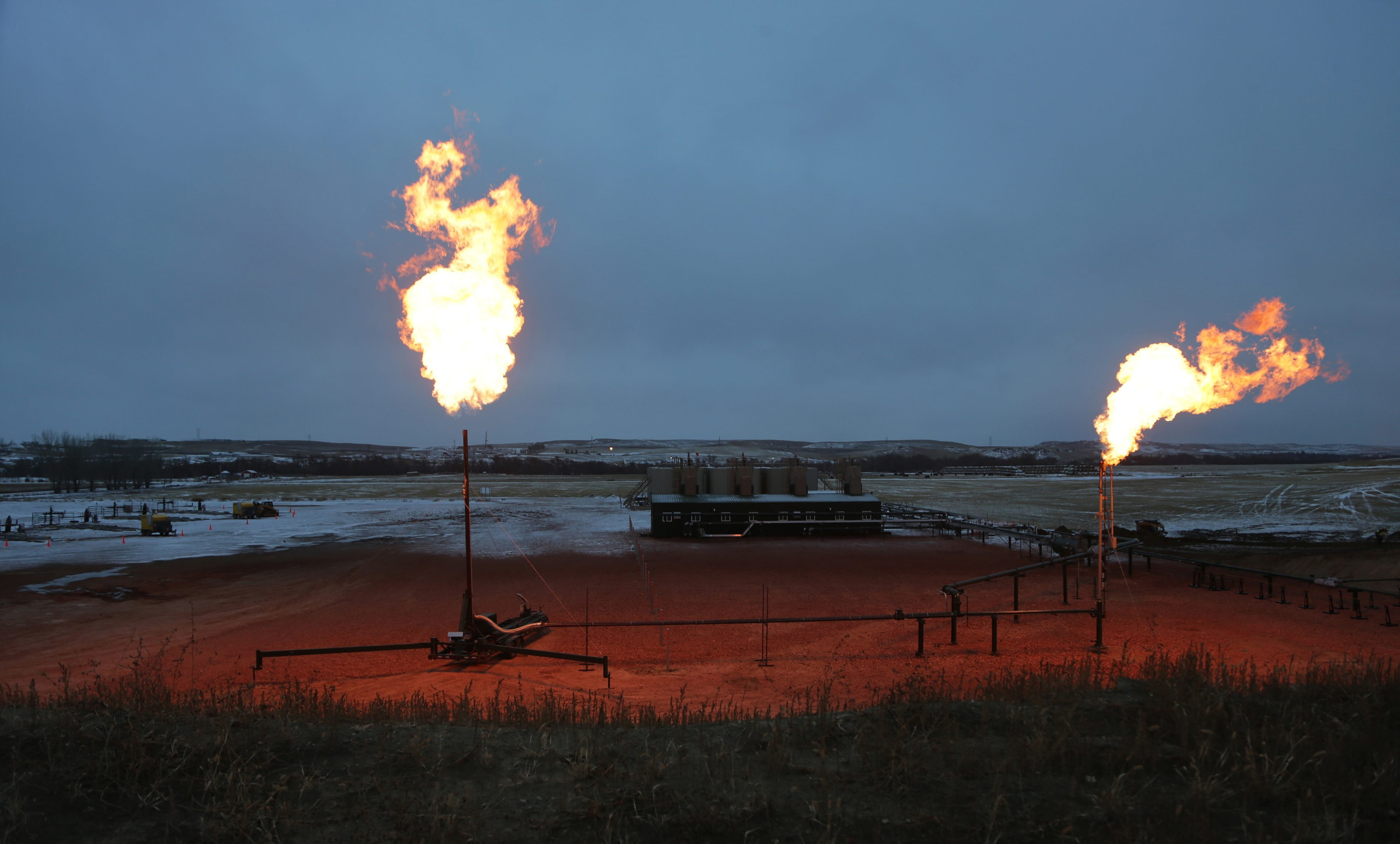 A Norwegian company is working with GE to capture the excess natural gas  that is burned off at flares like these in the Bakken oil field in McKenzie County, N.D., to save money and help clean the environment.