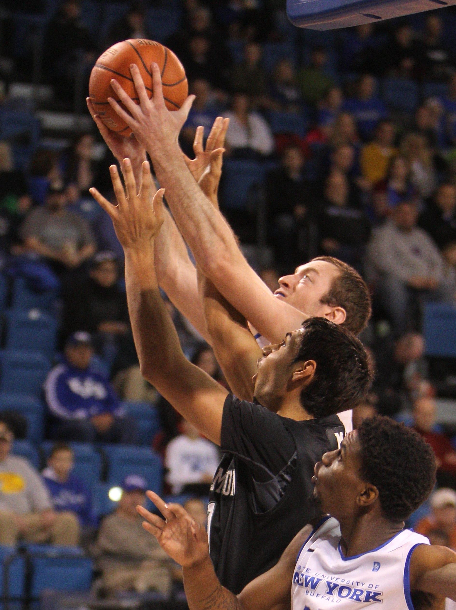 UB's Will Regan grabs one of his six offensive rebounds during Monday afternoon's triumph over Binghamton.