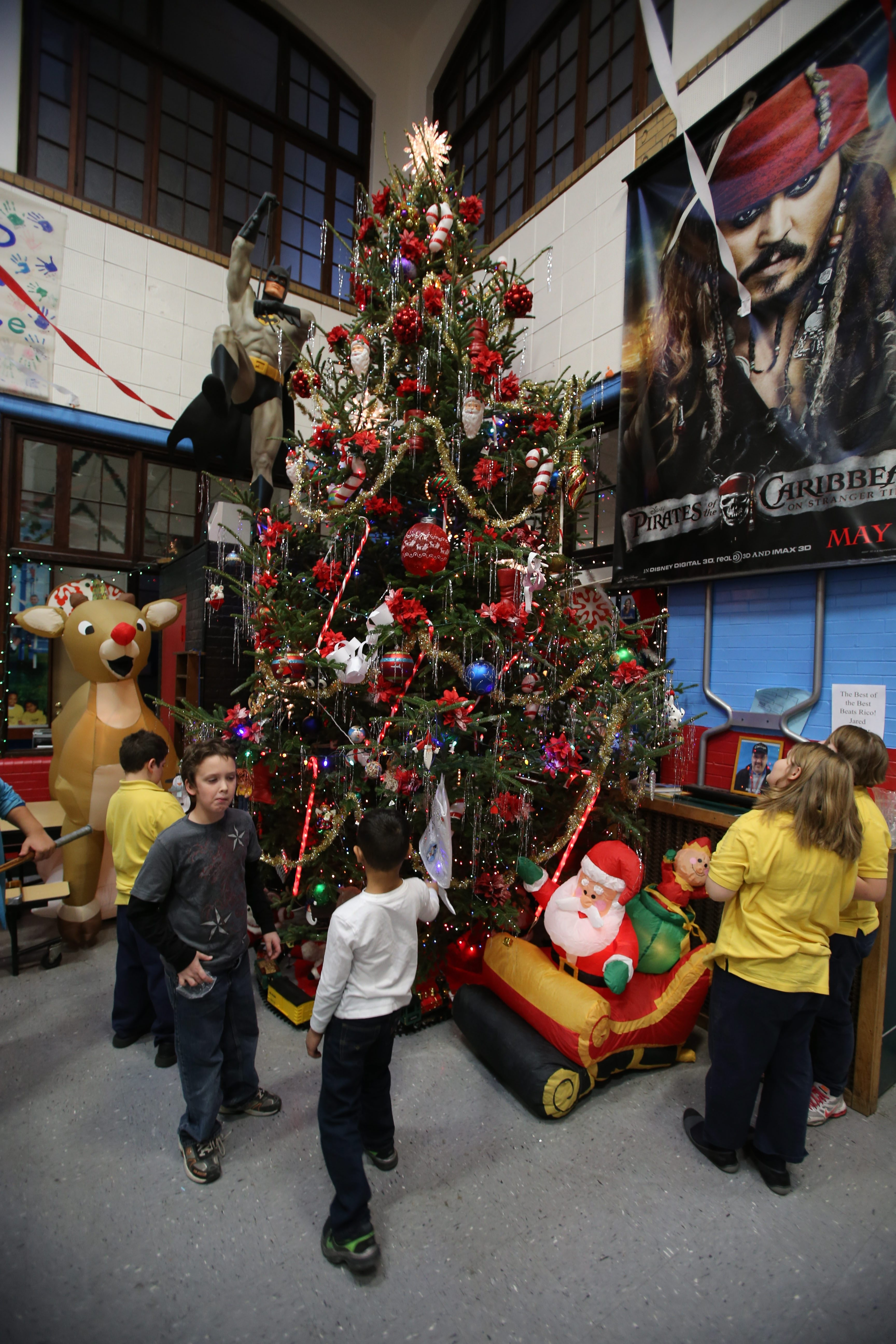 Youngsters check out the decorations on the 40-foot-tall blue spruce, which will be the centerpieces of today's annual Christmas party at the Town Boys & Girls Club in the Town of Tonawanda. The club is a participant in The News Neediest Fund.