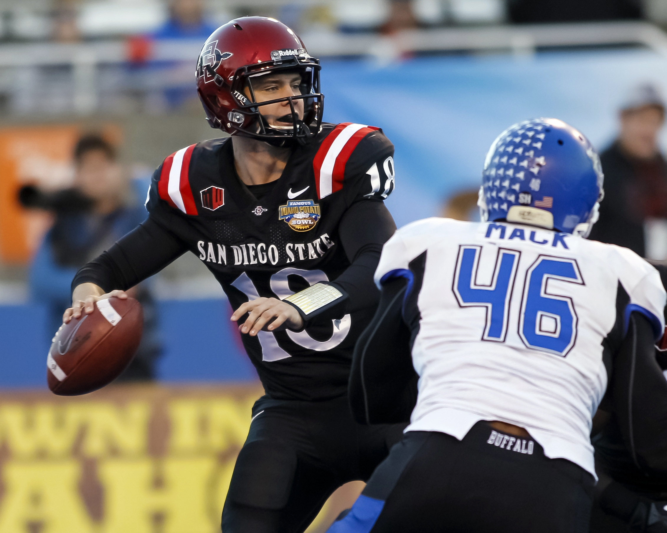 San Diego State quarterback Quinn Kaehler looks to throw as UB's Khalil Mack closes in during Saturday's contest in Boise, Idaho. (AP Photo/Otto Kitsinger)
