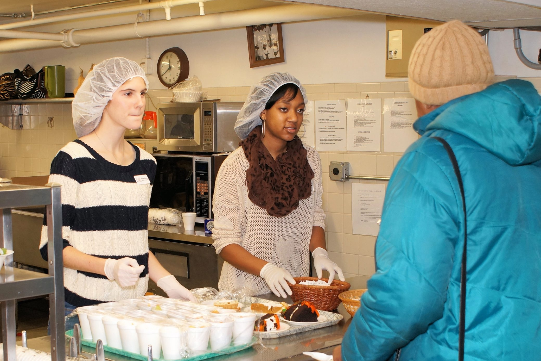 Volunteers from local high schools lend a hand at Community Missions of the Niagara Frontier, serving food in the Community Soup Kitchen.