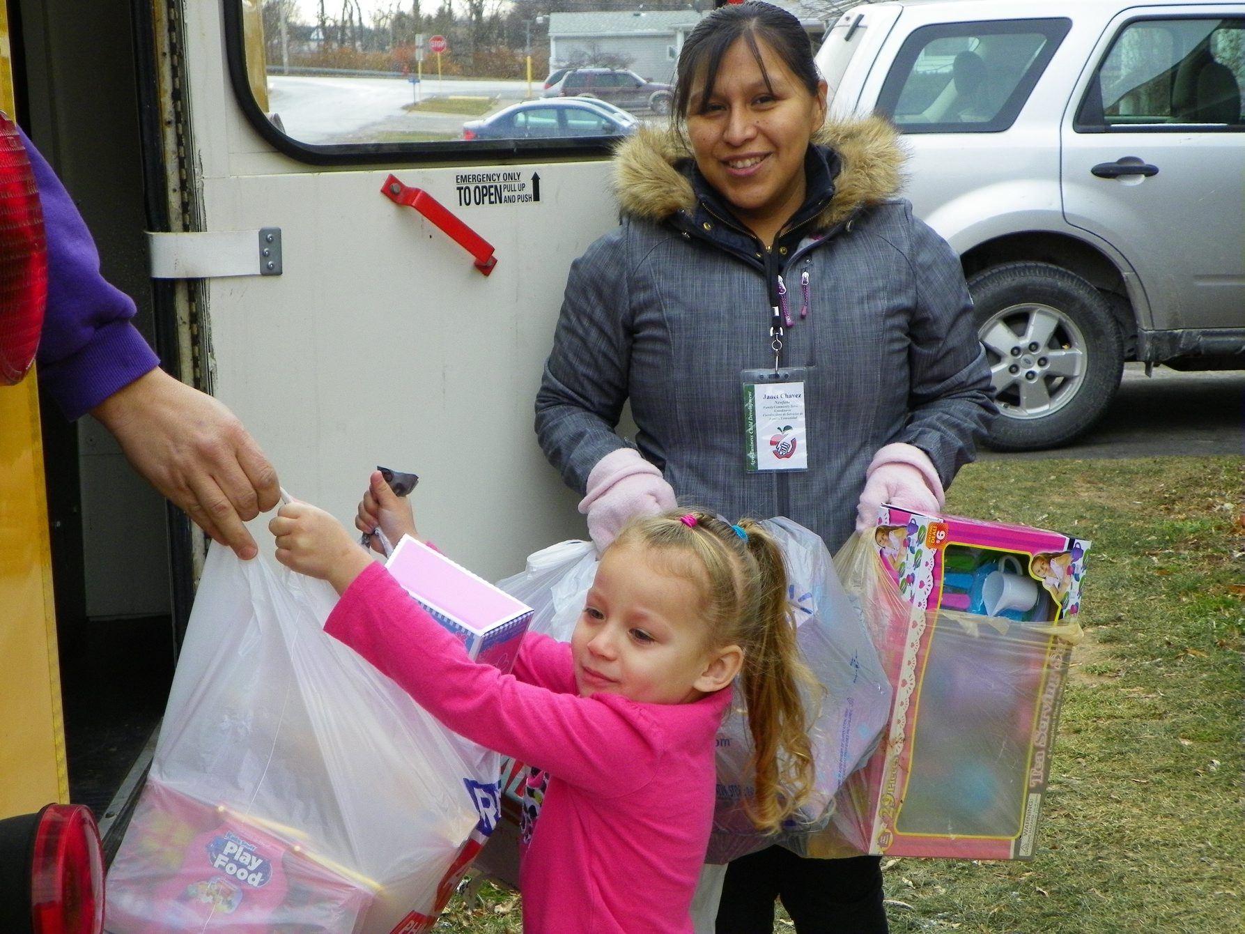 Janelle Rose Seeger, 4, helped Janet Chavez, family/community service coordinator for the ABCD Rathgaber Center of Newfane, unload donated toys last week .