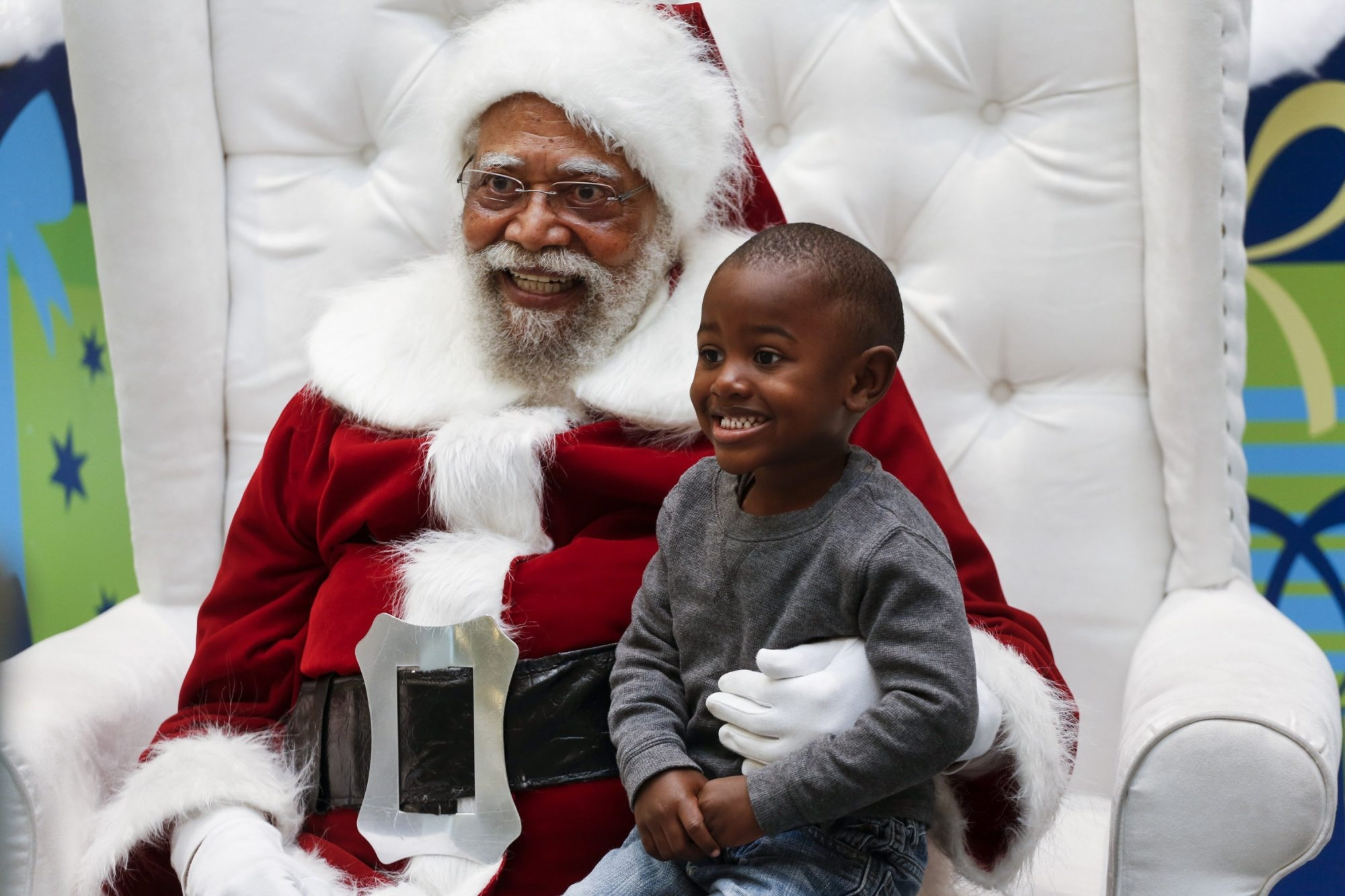 Jahleel Logan, 3, poses with Langston Patterson, 77, dressed as Santa Claus, at the Baldwin Hills Crenshaw Plaza in Los Angeles. The mall is one of the few in the country with a black Santa. Patterson has been Santa at the mall since 2004.
