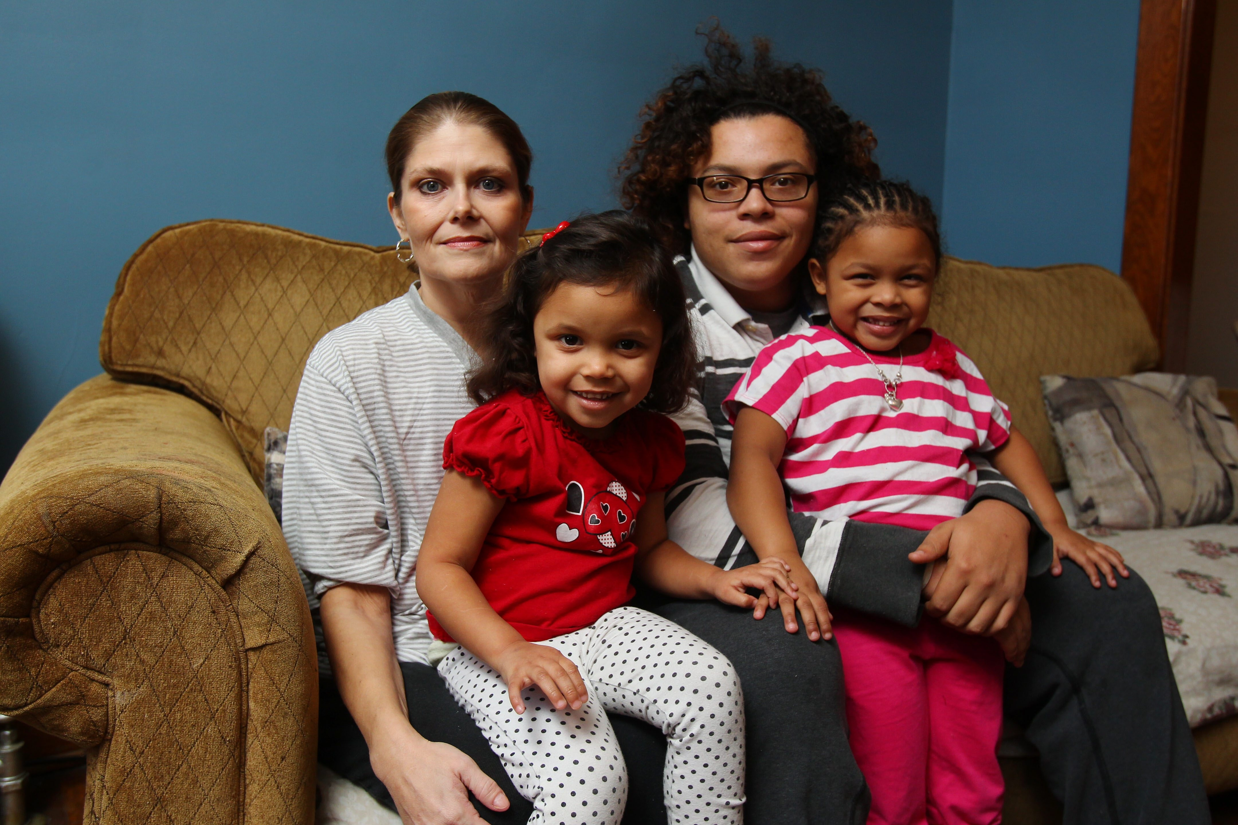 From left, single mom Sonia Whitlock poses in her Niagara Falls apartment with her children Summer, Wardy and Skylar. A car collision changed life forever for Whitlock and her family.