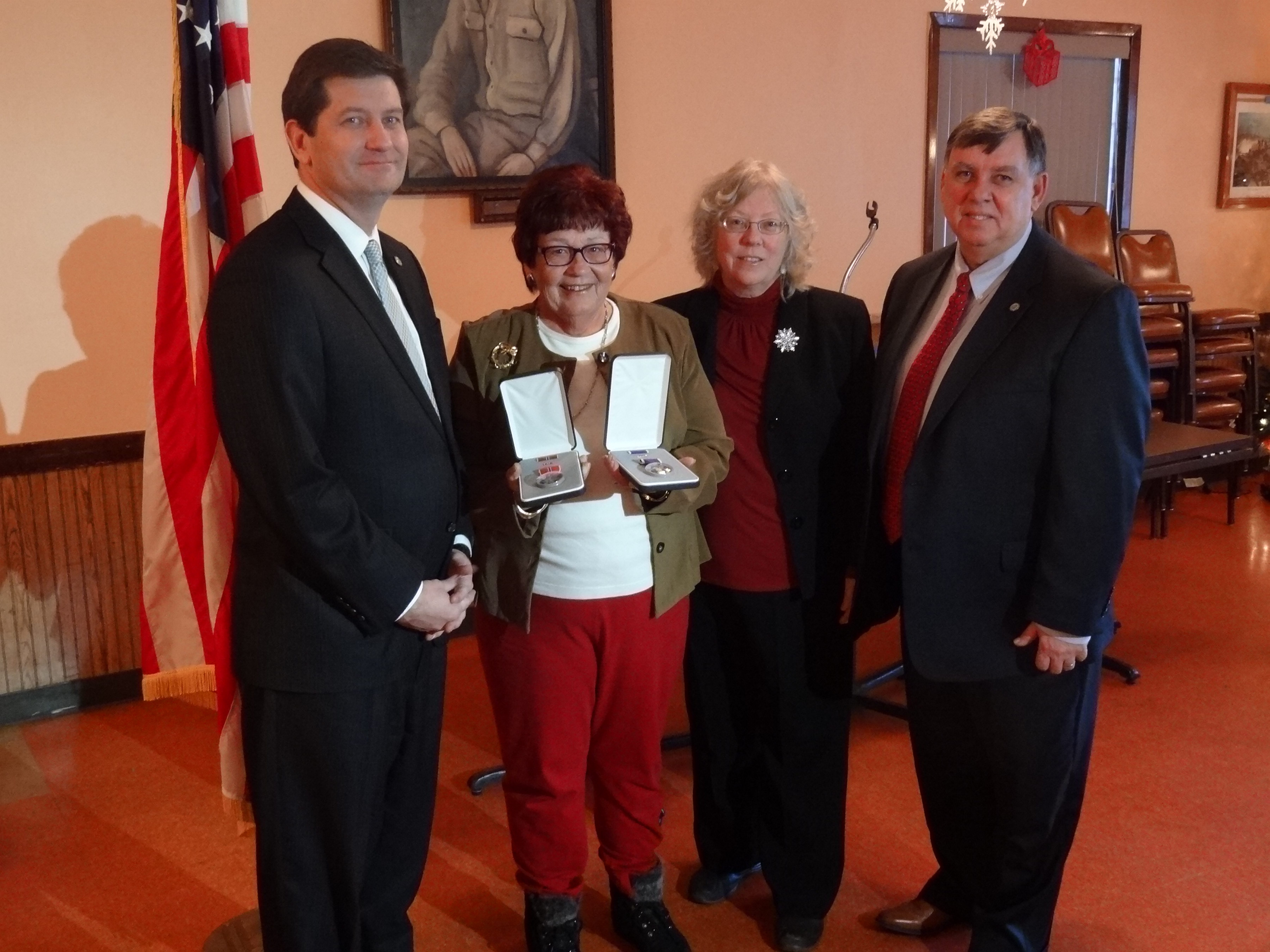 On Monday, Erie County Executive Mark C. Poloncarz, left, presented Rita Dudczak, 2nd left, with the long-lost military service medals of her father, World War II veteran  Vincent Mikolajczyk, who died in 1983. Also attending the presentation were Francis McLaughlin, right, director of the county Veteran Service Agency, and Felice Krycia, the agency's assistant director.