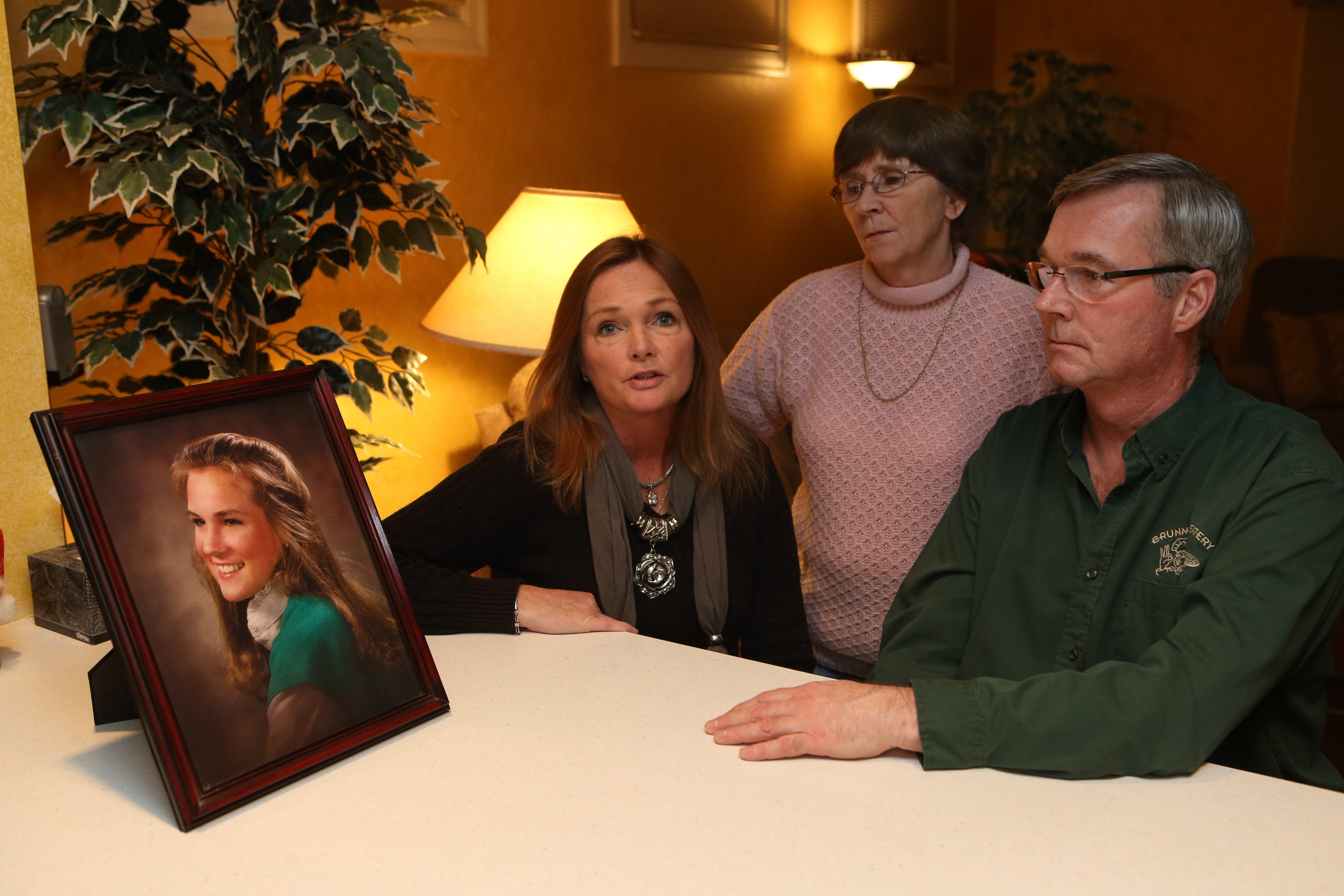 Portrait of Colleen Brunner, killed at 20, stirs emotions for siblings Patricia Brunner Collins, left, Cheryl Brunner and Bill Brunner.