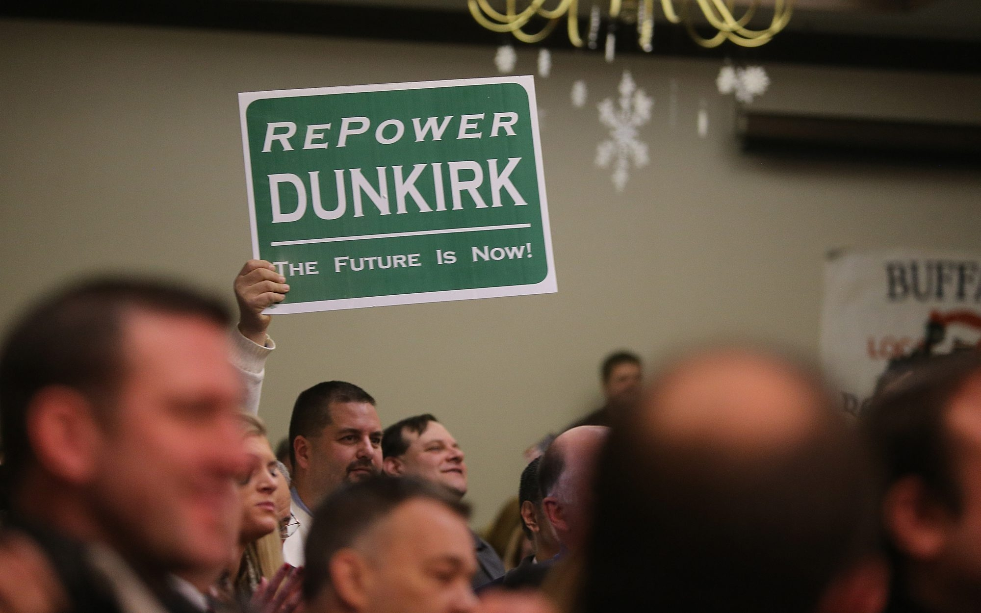 The sign expresses the sentiments of hundreds on hand this morning to hear Gov. Andrew M. Cuomo announce that Dunkirk's coal-fired power pant will be converted to natural gas and remain open.