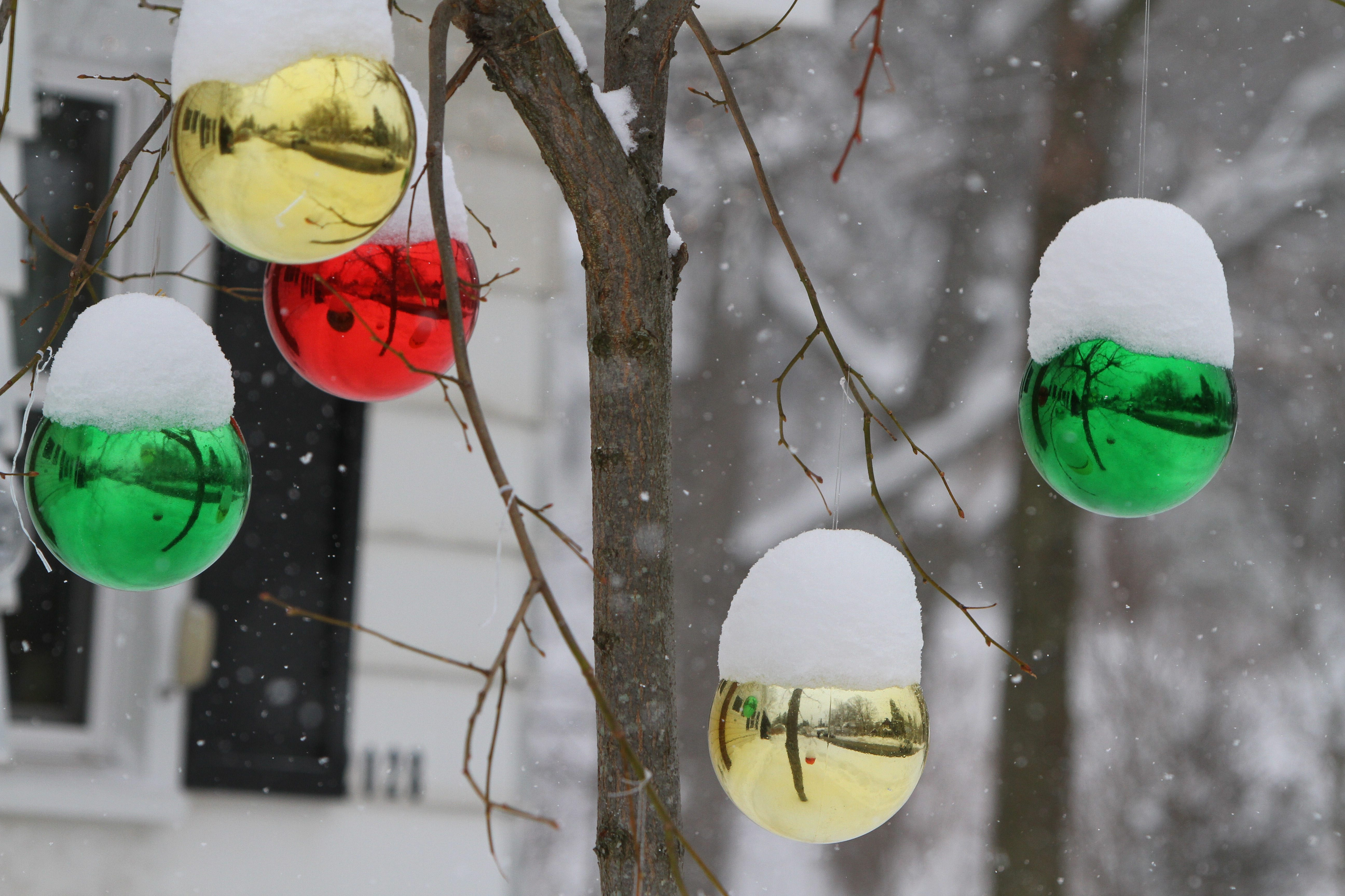 Snow piles on to Christmas decorations in the yard of a home in West Falls today. (Mark Mulville/Buffalo News)