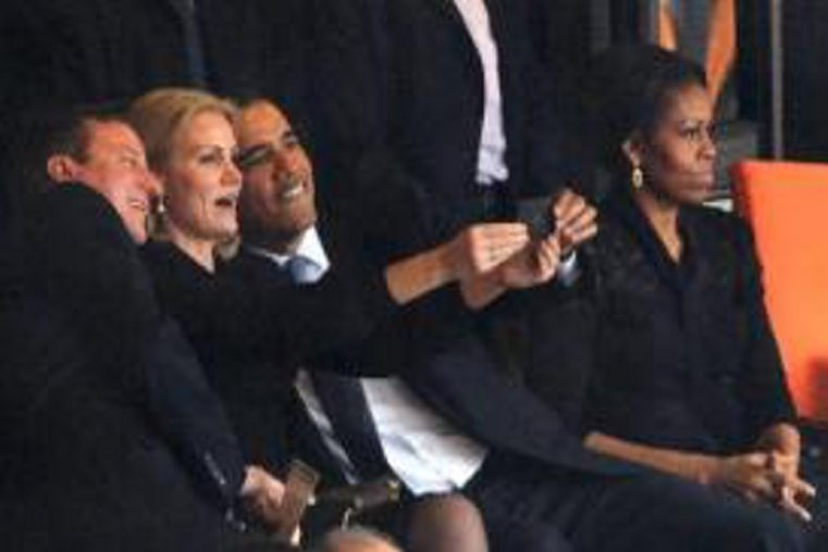 """Danish Premier Helle Thorning-Schmidt takes """"selfie"""" with British Premier David Cameron and President Obama as first lady Michelle Obama watches cremonies."""