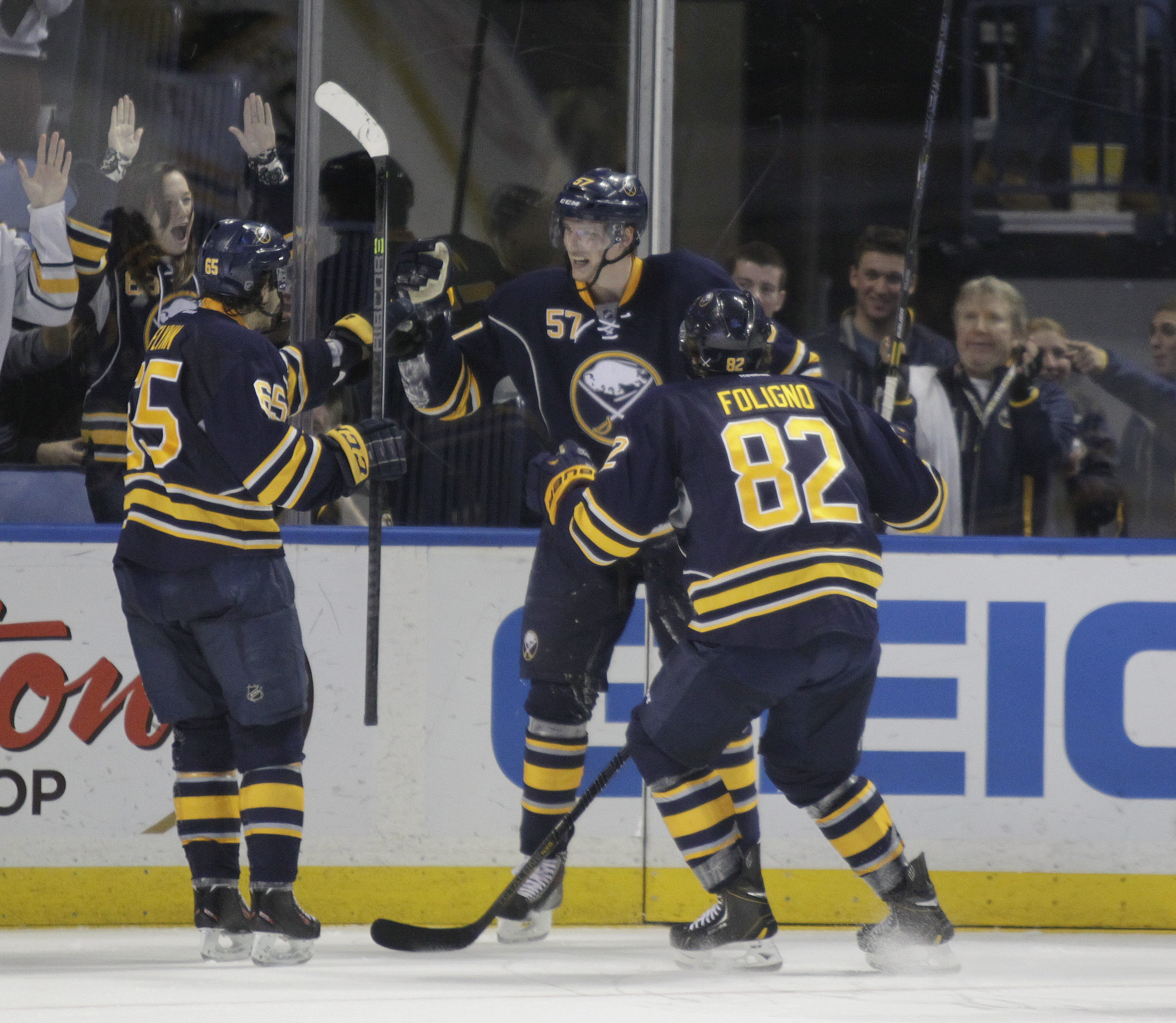 Tyler Myers celebrates the Sabres' fourth goal during the third period against Boston Thursday.