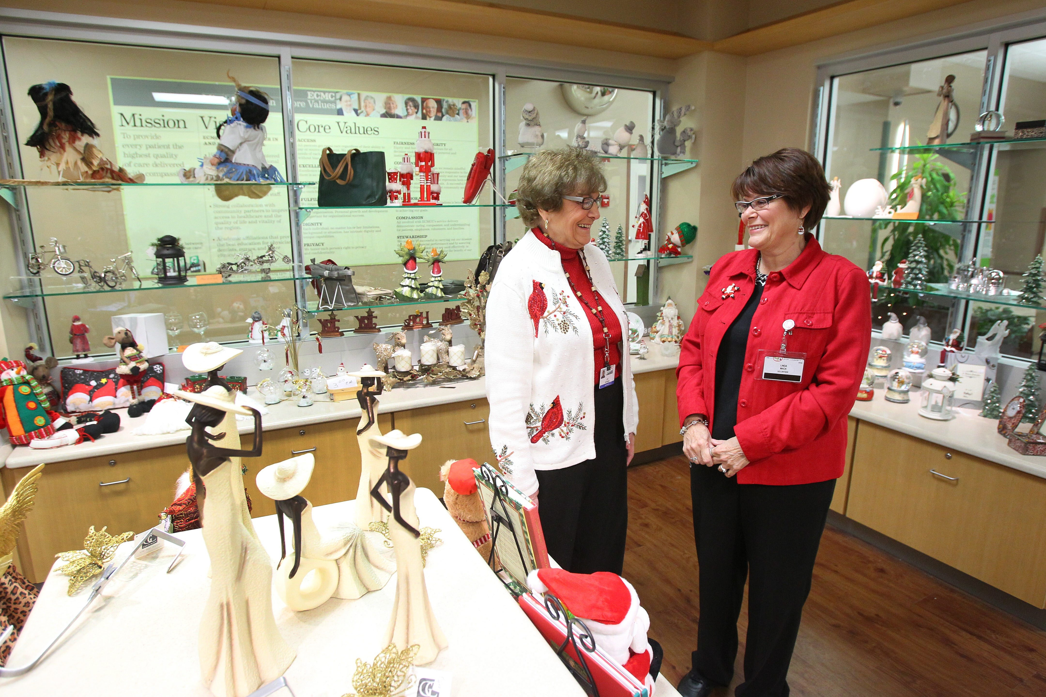 Volunteers Lois Peterson, left, and Linda Mack, right, at the Gift Shop in ECMC on Dec. 11, 2013.