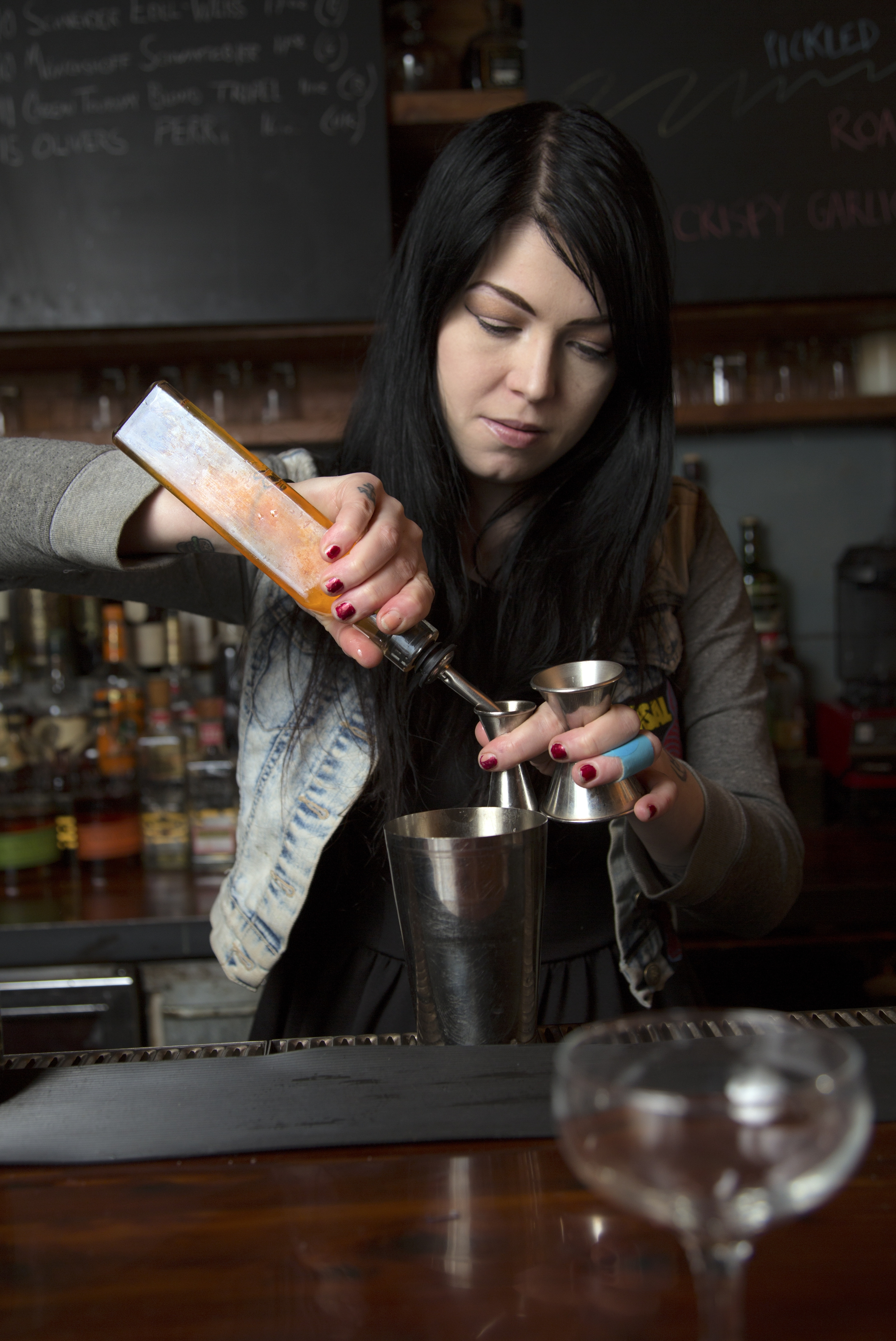 """Tonia Guffey head bartender at Dram, makes her pleasingly complex """"Snowbirds and Townies""""  cocktail in New York, Nov. 25, 2013. The cocktail is one of seven new concoctions created by mixologists for the holidays. (Tony Cenicola/The New York Times)"""