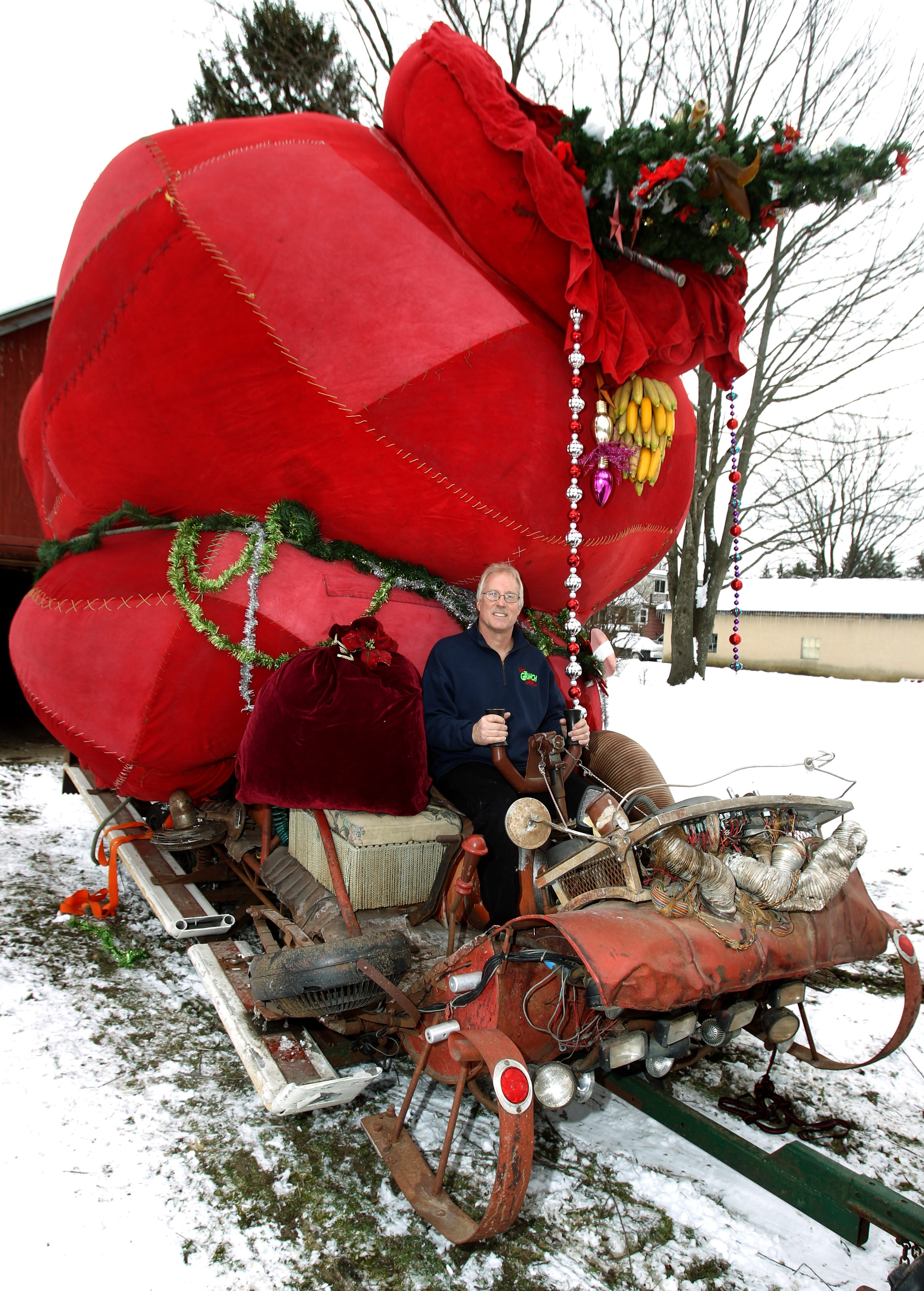 "East Aurora Grinch collector Dave Howes with his Grinch sled, one of two used in the movie ""How the Grinch Stole Christmas,"" at his home in East Aurora."