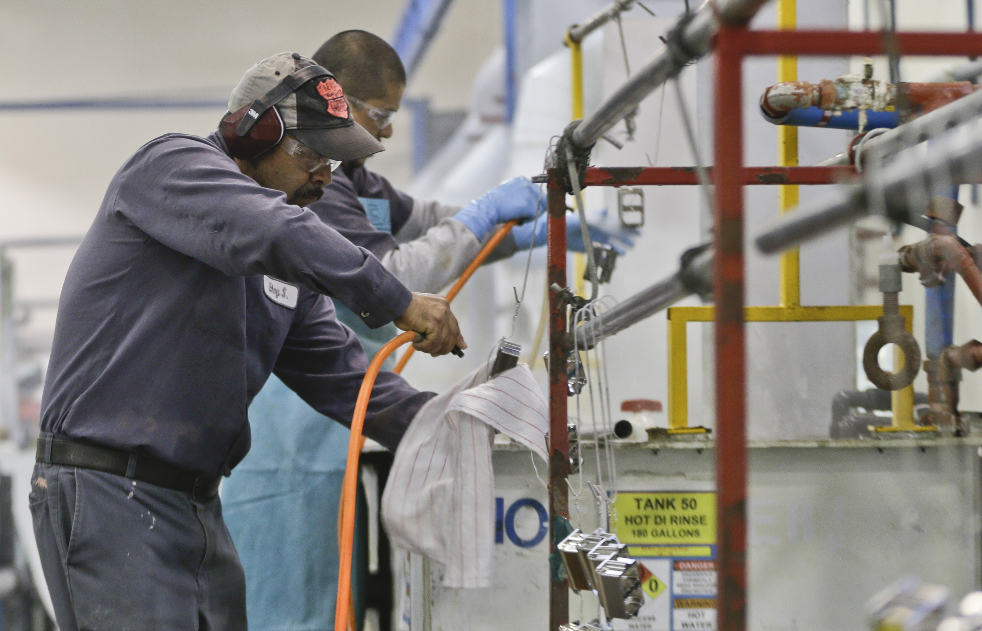 Employees at Sheffield Platers Inc. work on the factory floor in San Diego. The Institute for Supply Management manufacturing index rose to its highest point since April 2011.