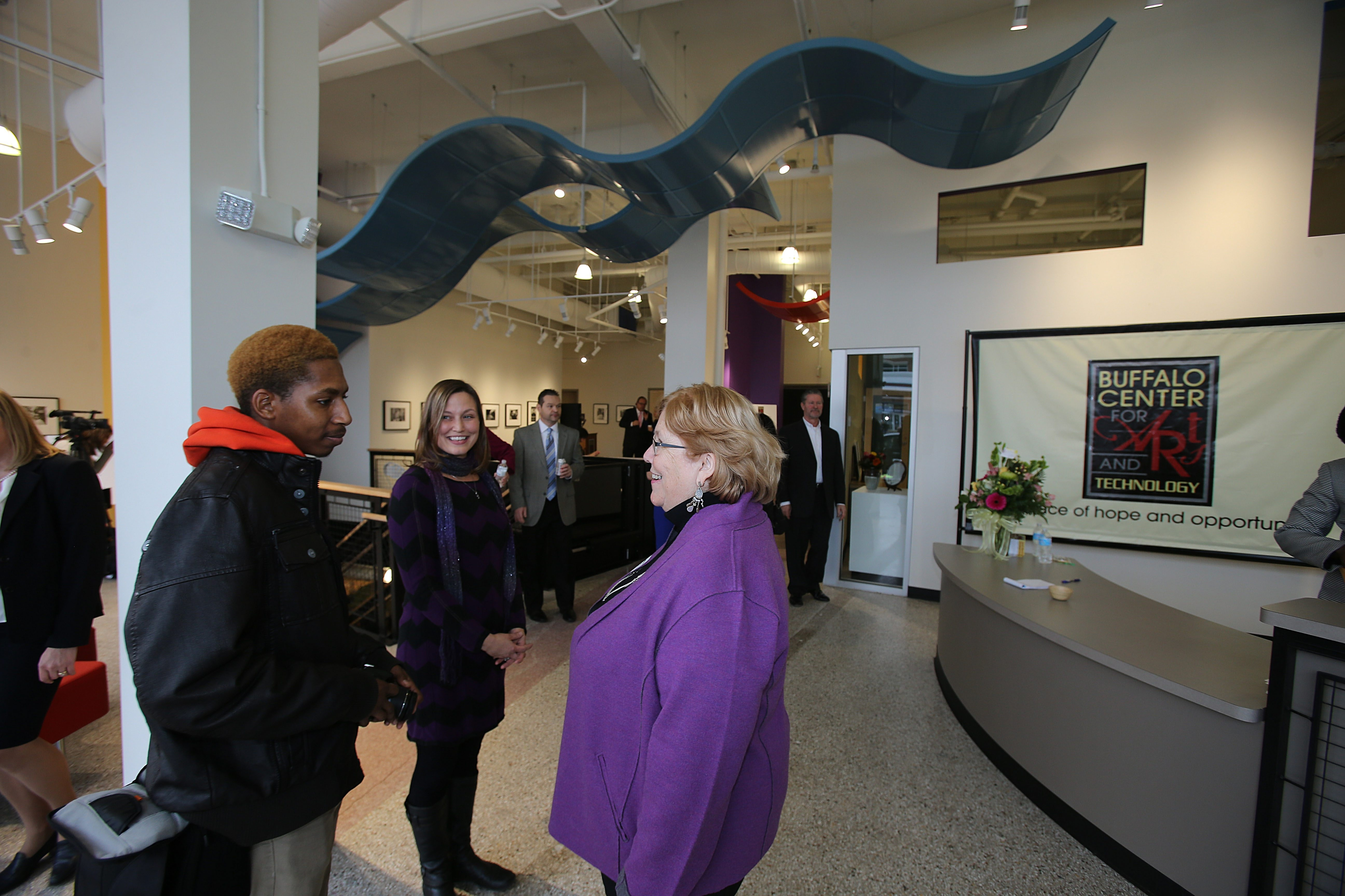 Executive Director Amber Dixon, right, chats with student Denard Hemphill, left, and Bennett High School teacher Ann Crittenden at the Buffalo Center for the Arts and Technology Friday. See a photo gallery of the center's grand opening at BuffaloNews.com.