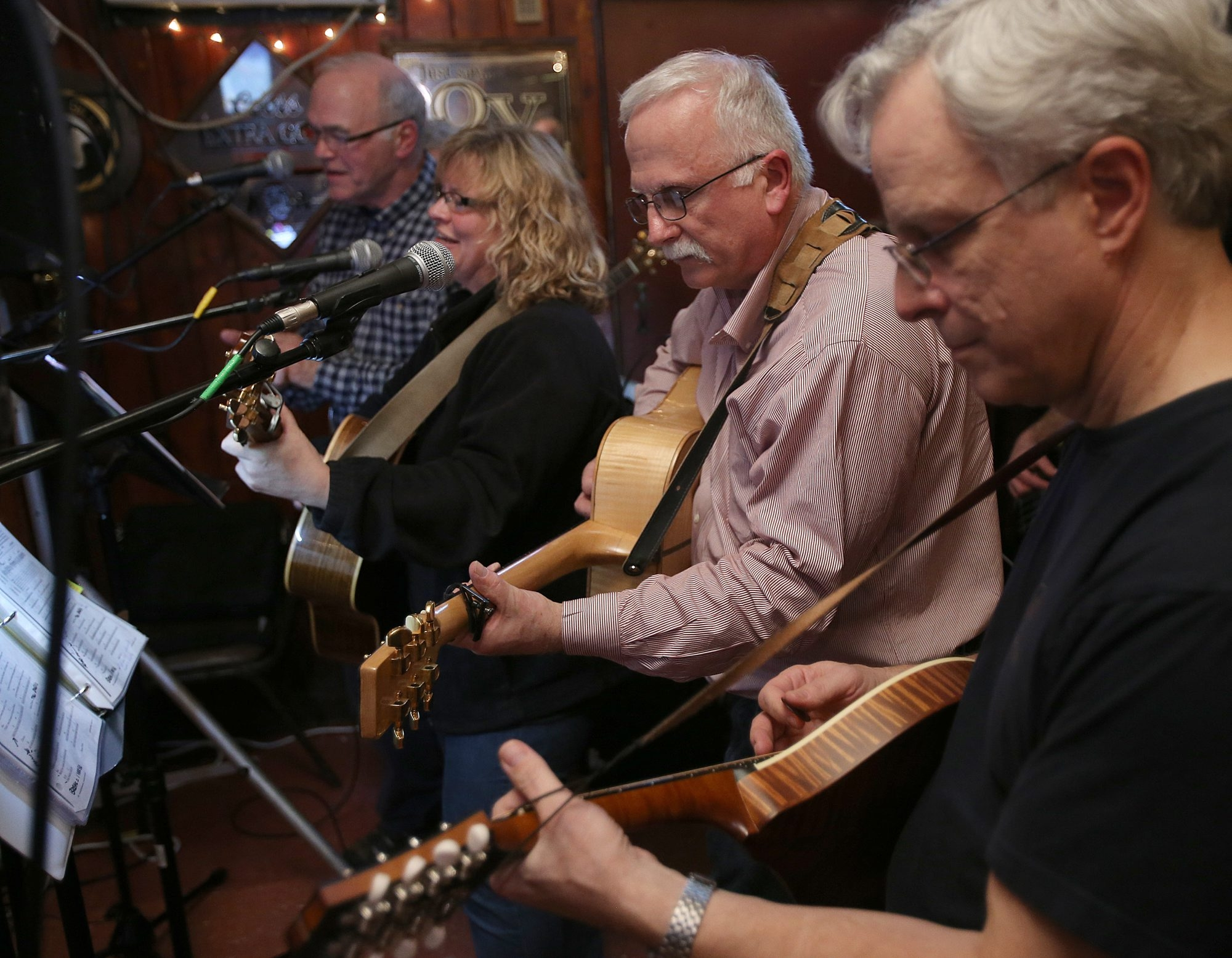 A mix of musicians play together during the Charlie O'Neill Unplugged Club on the first Monday of the month in Talty's Tavern.