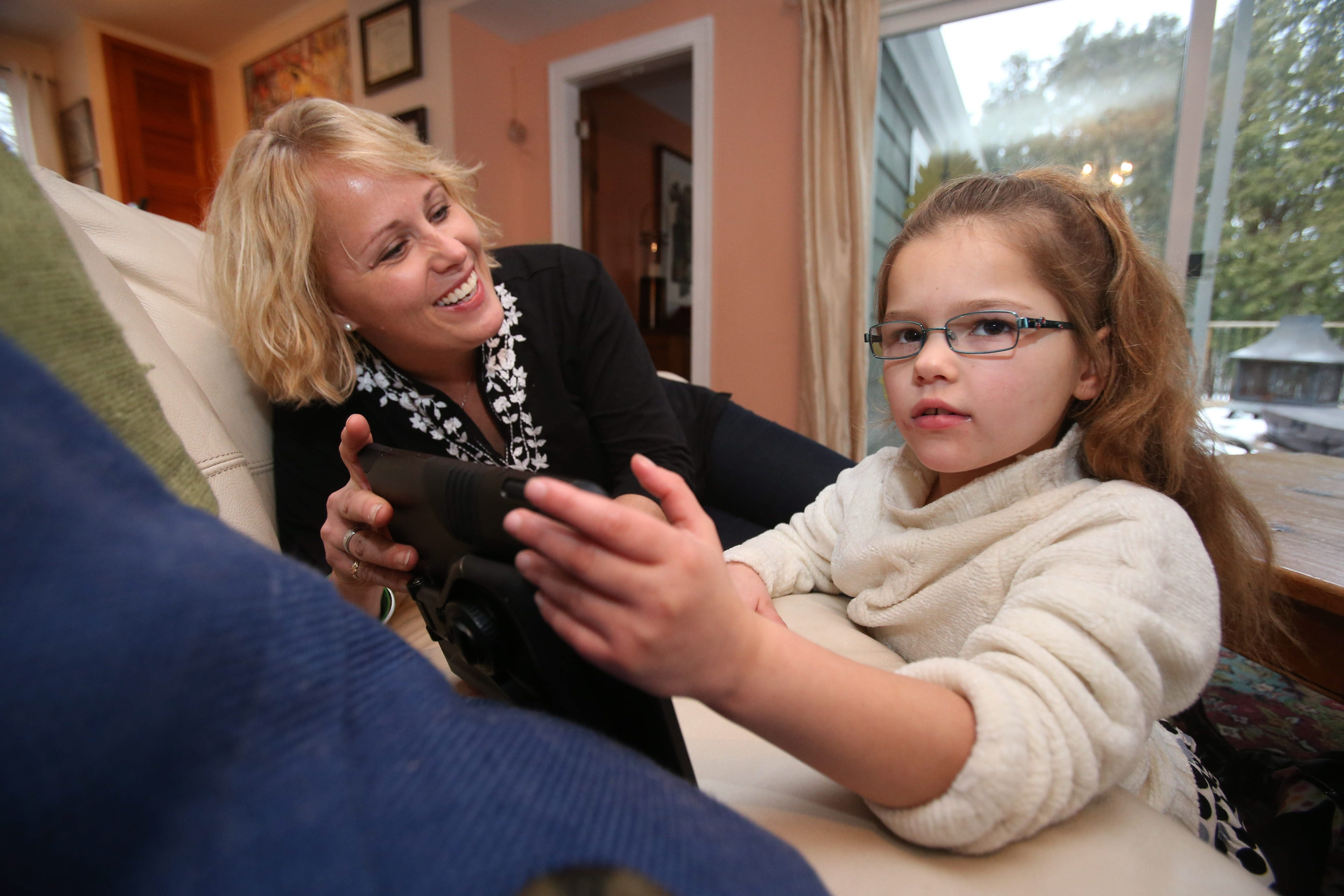 Wendy Conte spends time with 8-year-old Anna, who has suffered epileptic seizures since she was 2 months old.