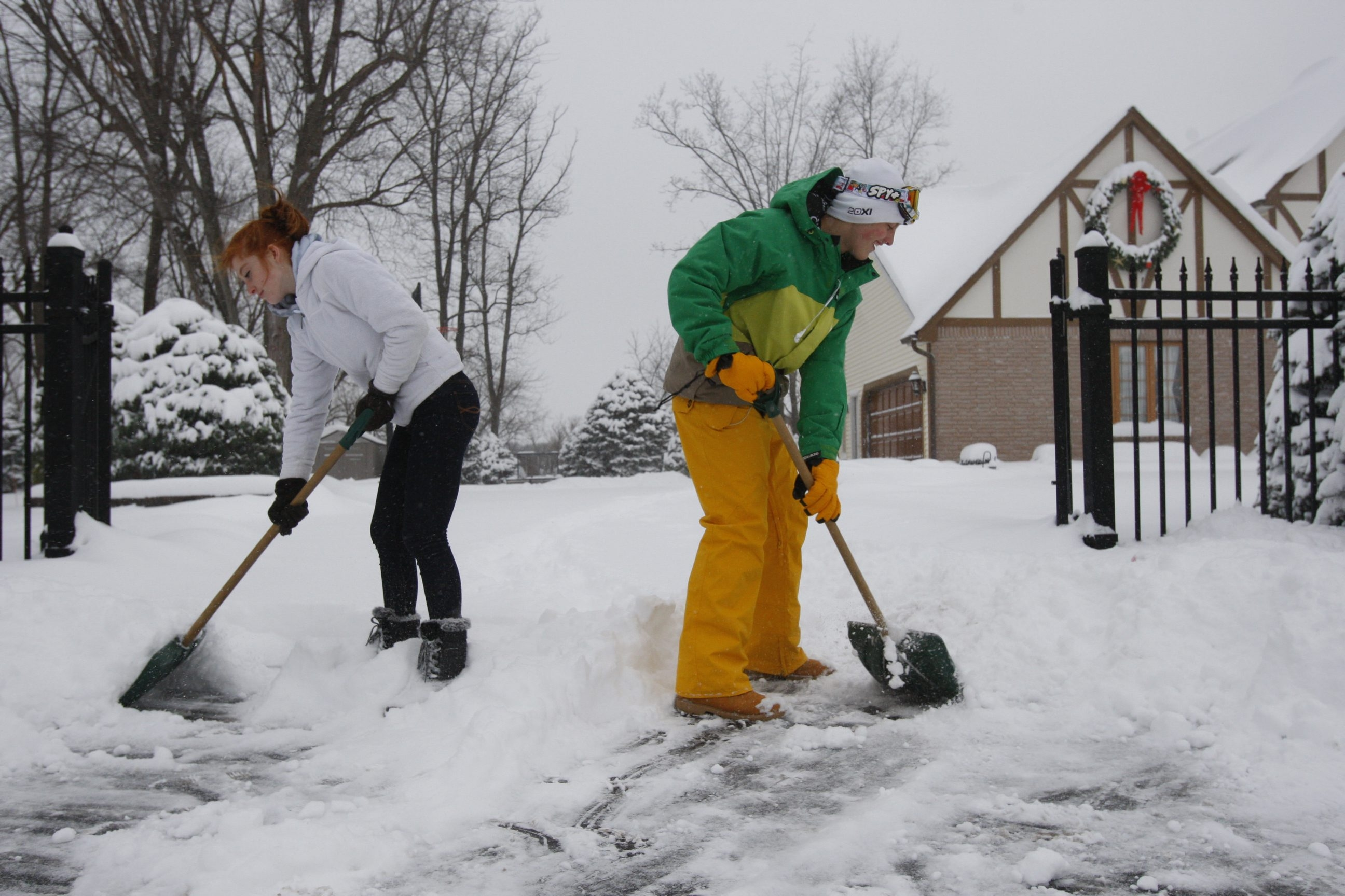 Twins Danielle and Chris Janek, 15, shovel out their parents' driveway along Route 391 in Hamburg, prior to their parents coming home, as more than two feet of snow fell Wednesday.