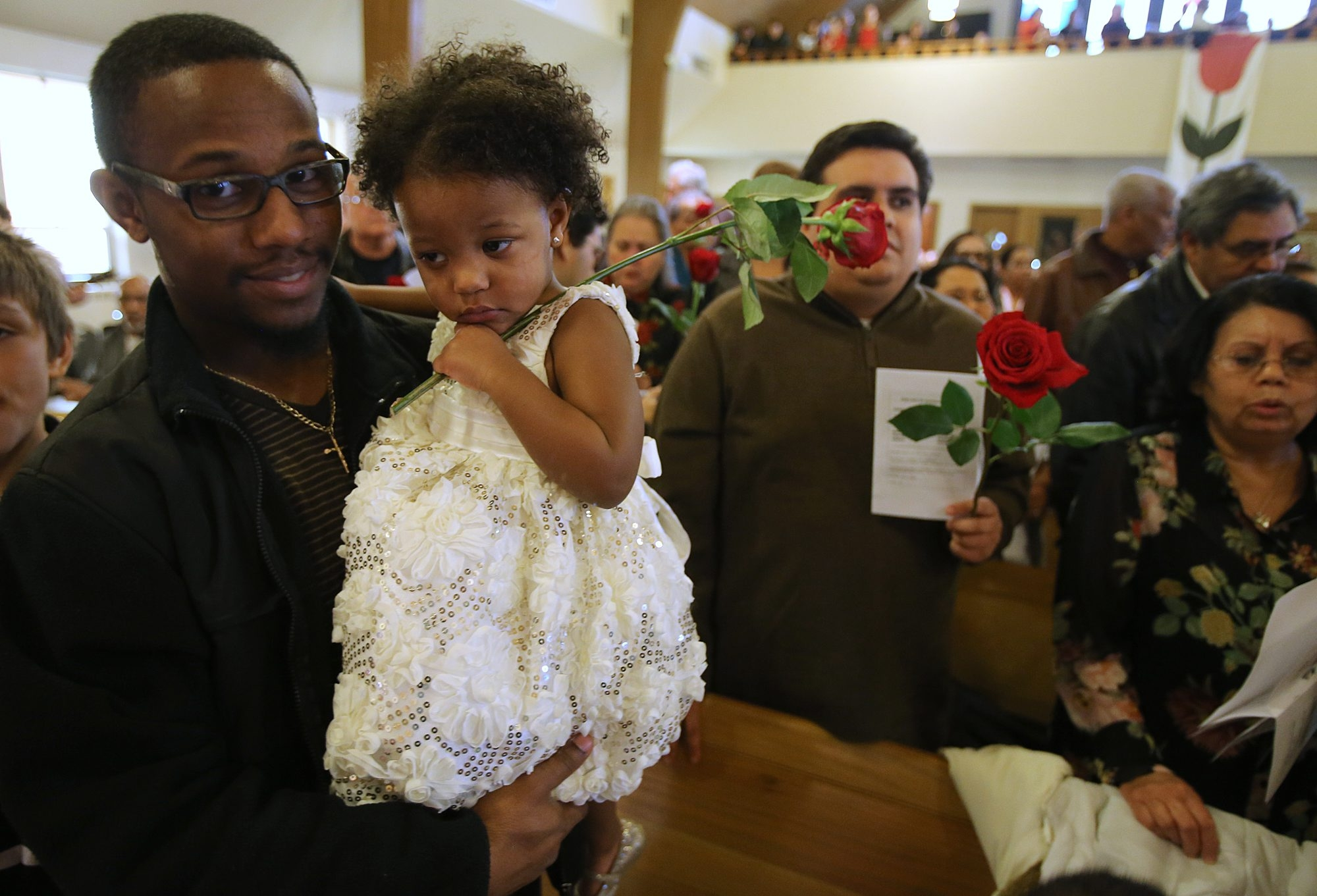Daniel Soto holds his daughter Mariso, 2, at St. Anthony of Padua Catholic Church in Lackawanna, during the Feast of Our Lady of Guadalupe Mass on Sunday.