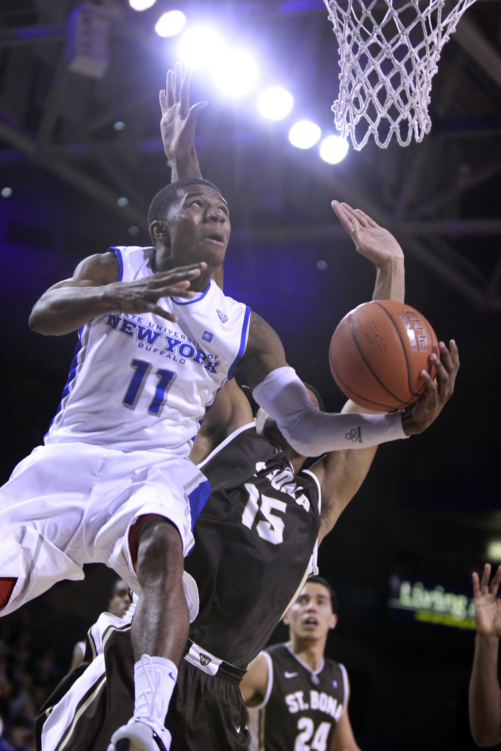 UB's Shannon Evans (11) drives past St. Bonaventure's Chris Dees in the second half. Evans had 15 of his 17 points in the final 20 minutes for the Bulls.
