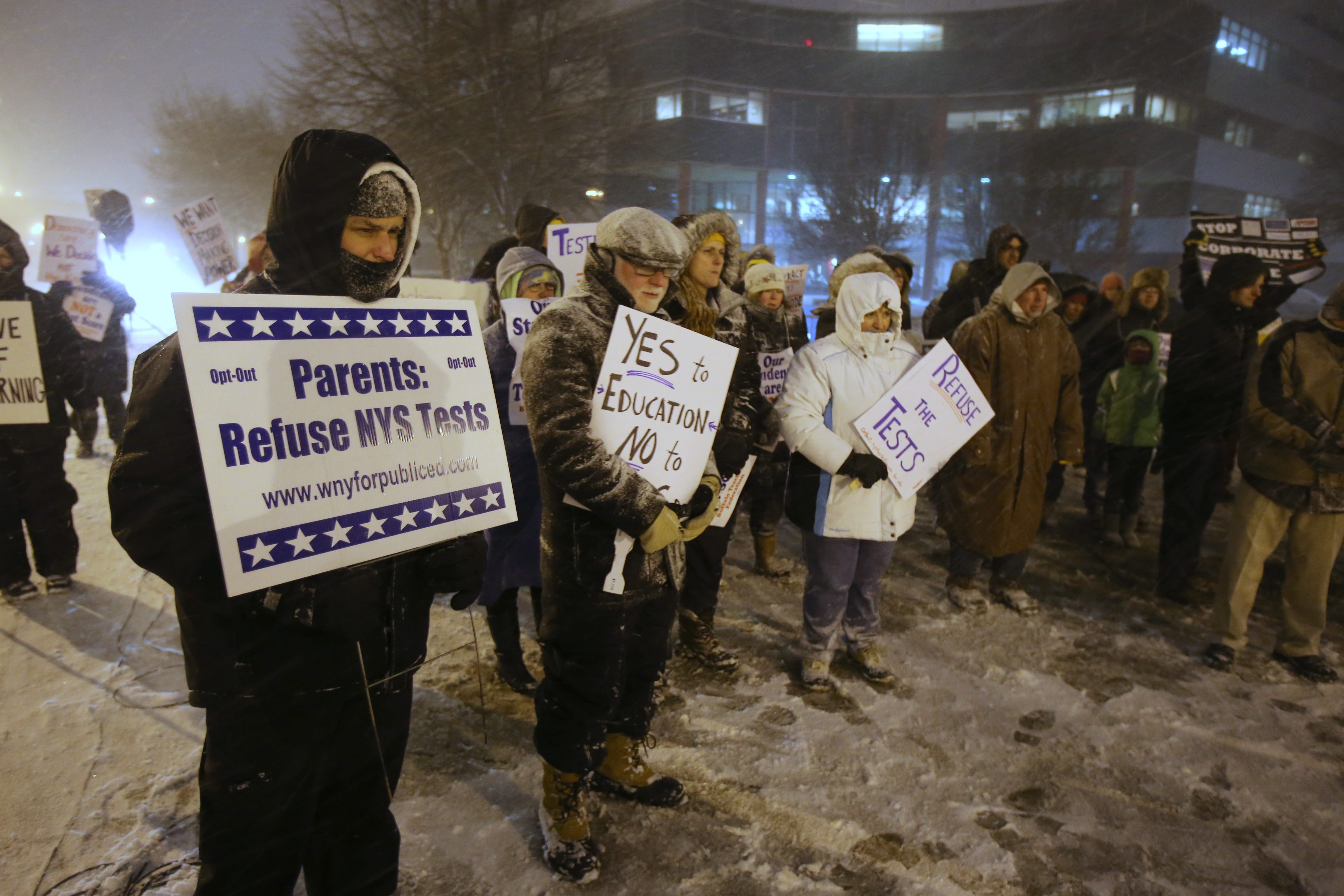 Protesting teachers and parents make their views known about state's Common Core standards and testing as they picket outside WNED studios during forum featuring Education Commissioner John B. King Jr.