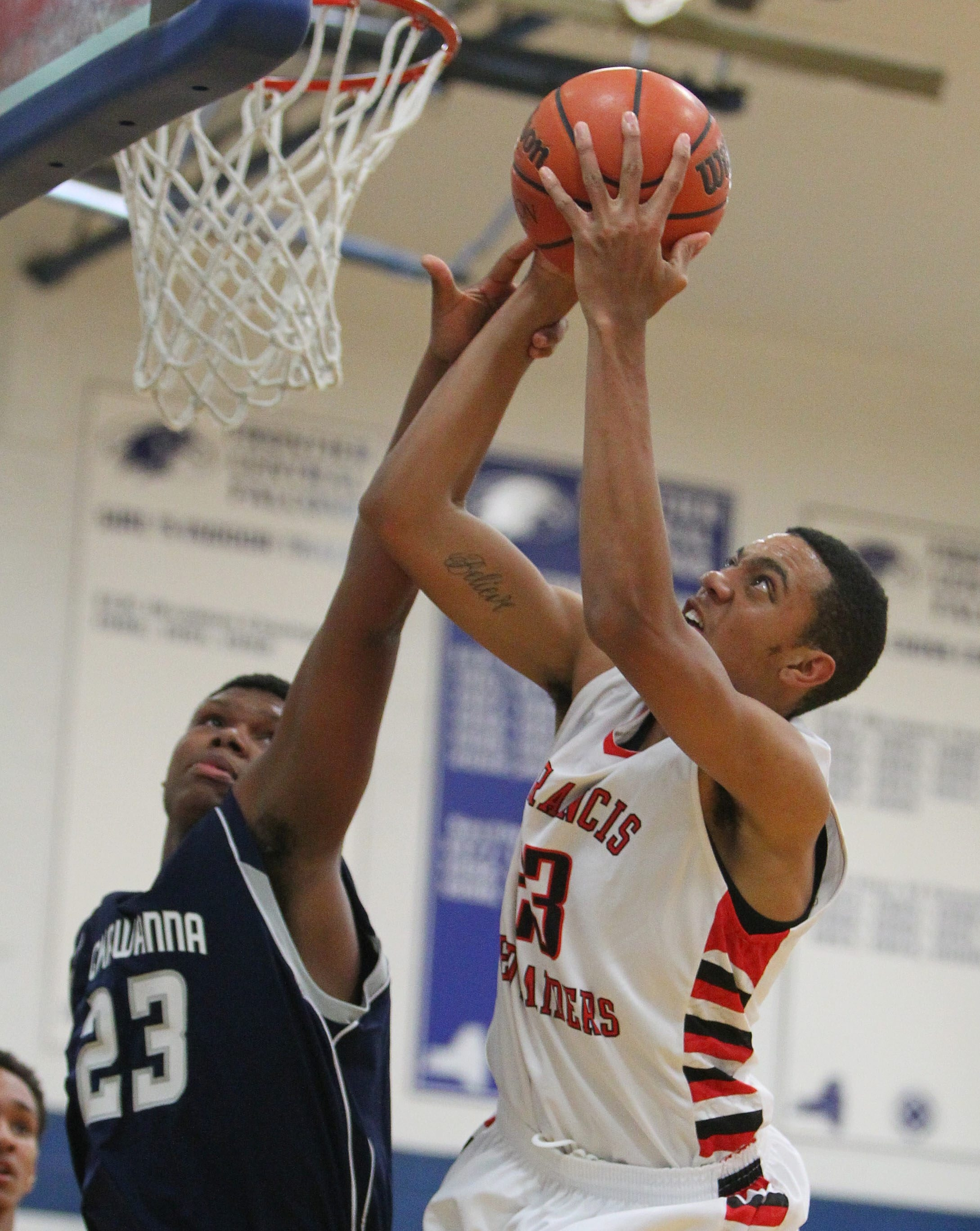 St. Francis' Trey Holness and Lackawanna's Larry Fields battle during the Town of Hamburg Lions Club Tournament.