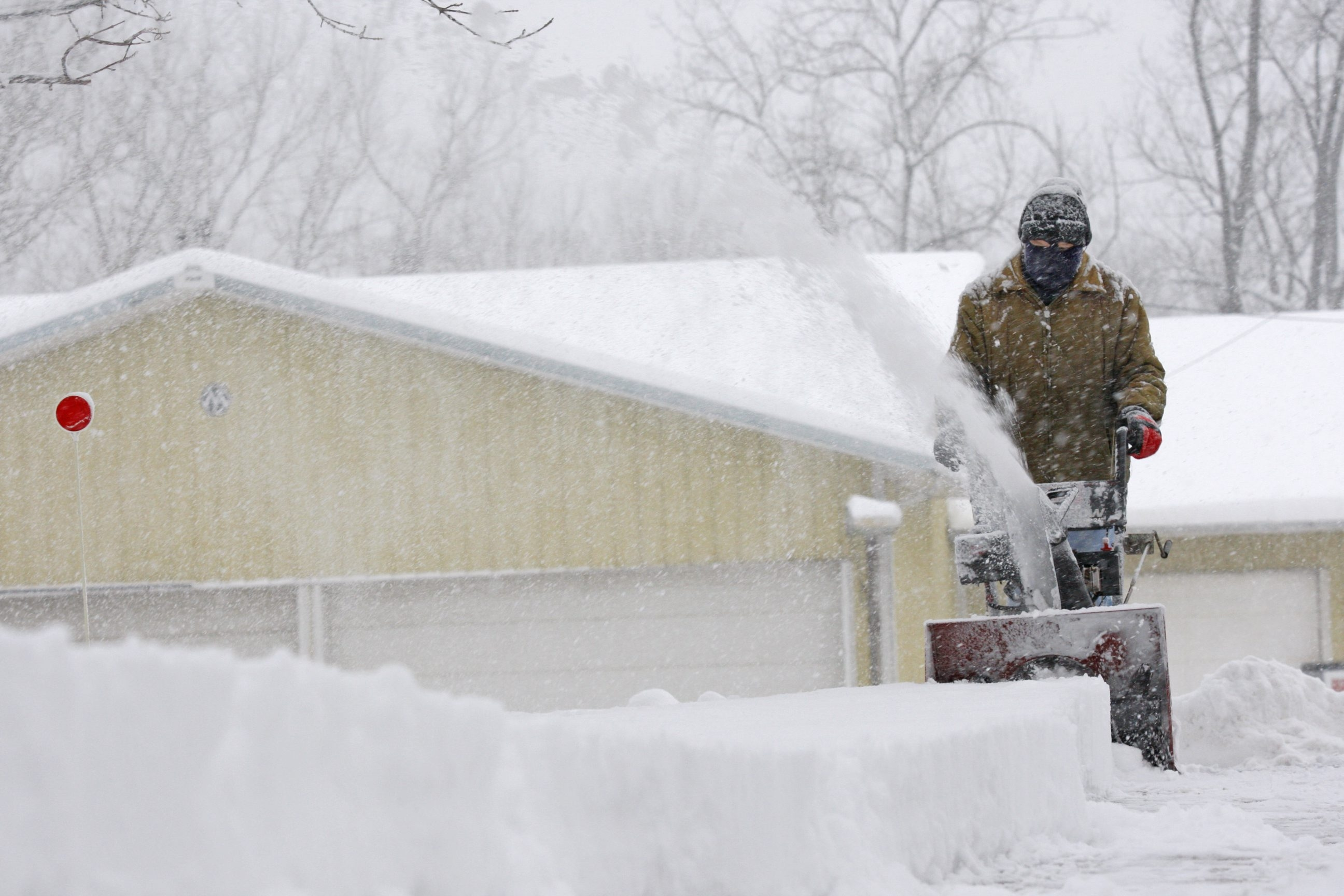 Guy Blodgett snowplows his driveway along Route 391 in Boston as more than two feet of snow fell on Wednesday.