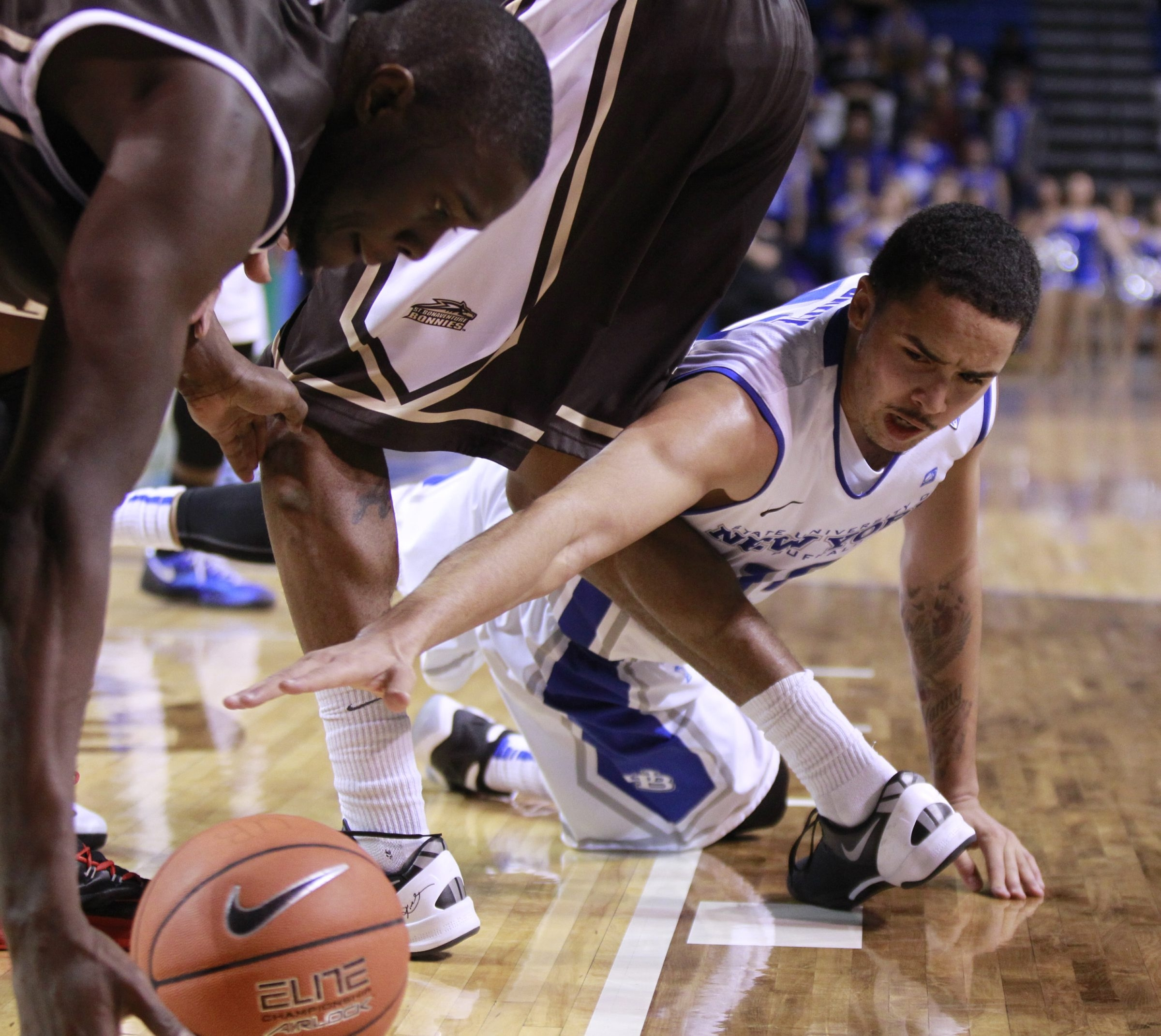 Buffalo basketball player,Jarryn Skeete (10) battles for a loose ball with St. Bonaventure  player, Youssou Ndoye (35) during second half action at Alumni Arena,on,Saturday, Dec. 7, 2013(Harry Scull Jr./Buffalo News)