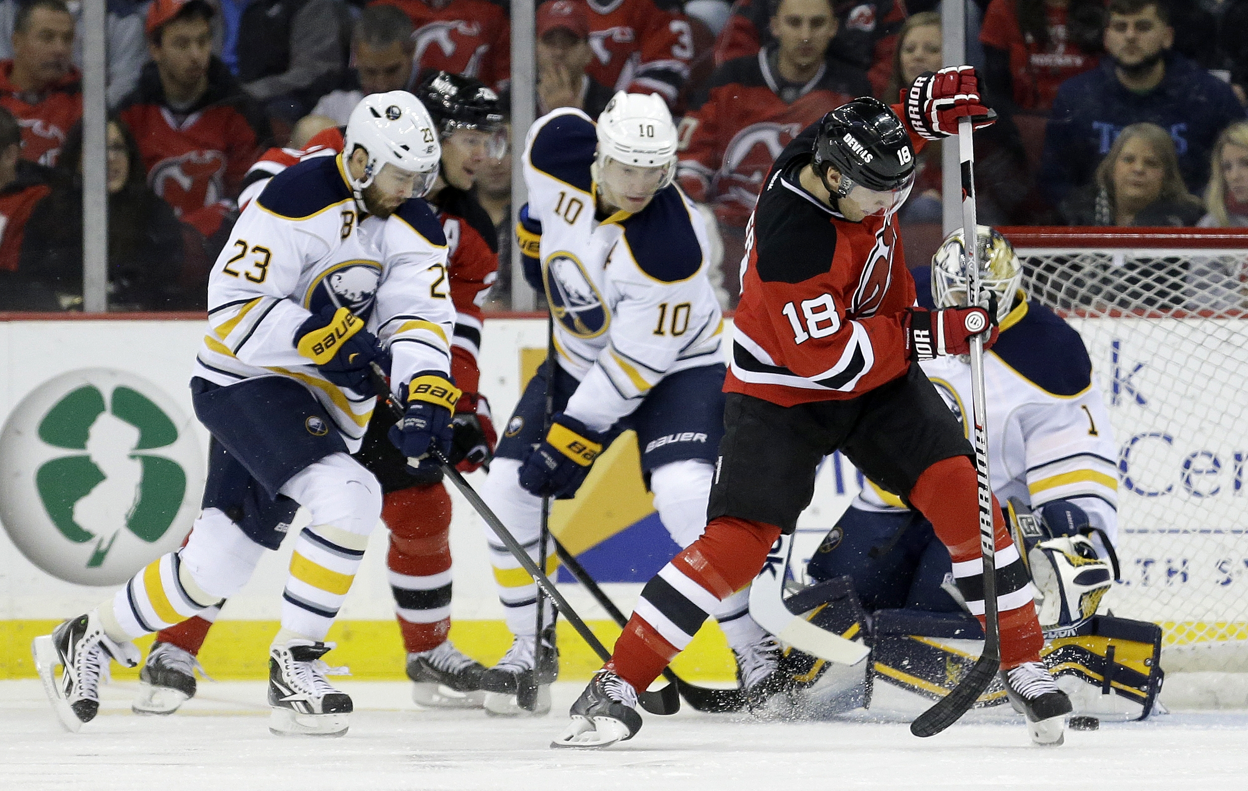 Devils winger Steve Bernier tries to muster a shot against Sabres goalie Jhonas Enroth as Buffalo's Ville Leino (23) and Christian Ehrhoff defend.