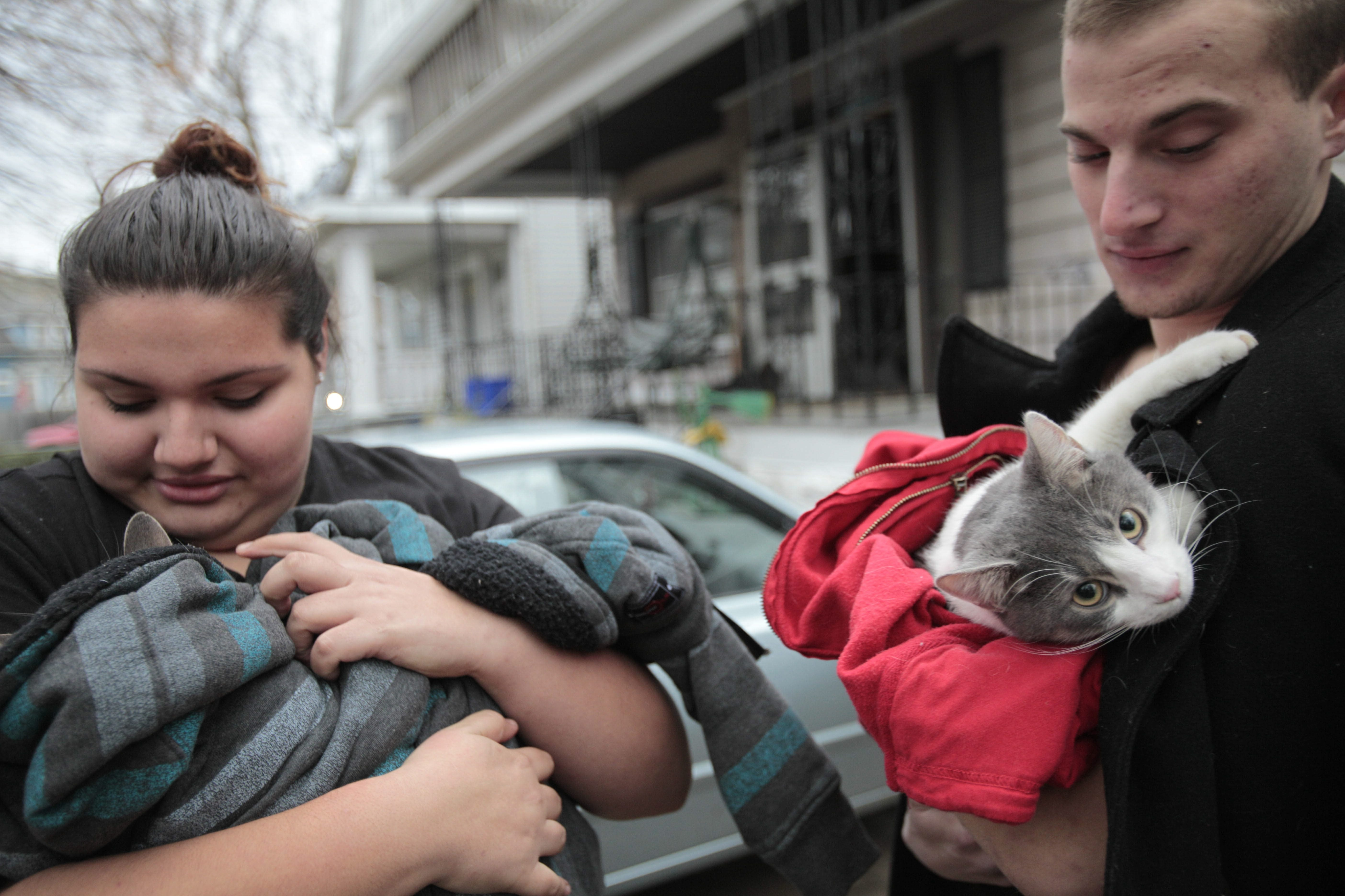 Amelia Luciano and Brett Lukasiewicz hold their cats, Lola and Sully respectively, after being routed from their home at 54 Remoleno St.in South Buffalo by an early morning fire. Their roommate was transported to South Buffalo Mercy Hospital. The cats were rescued from their apartment by firefighters.
