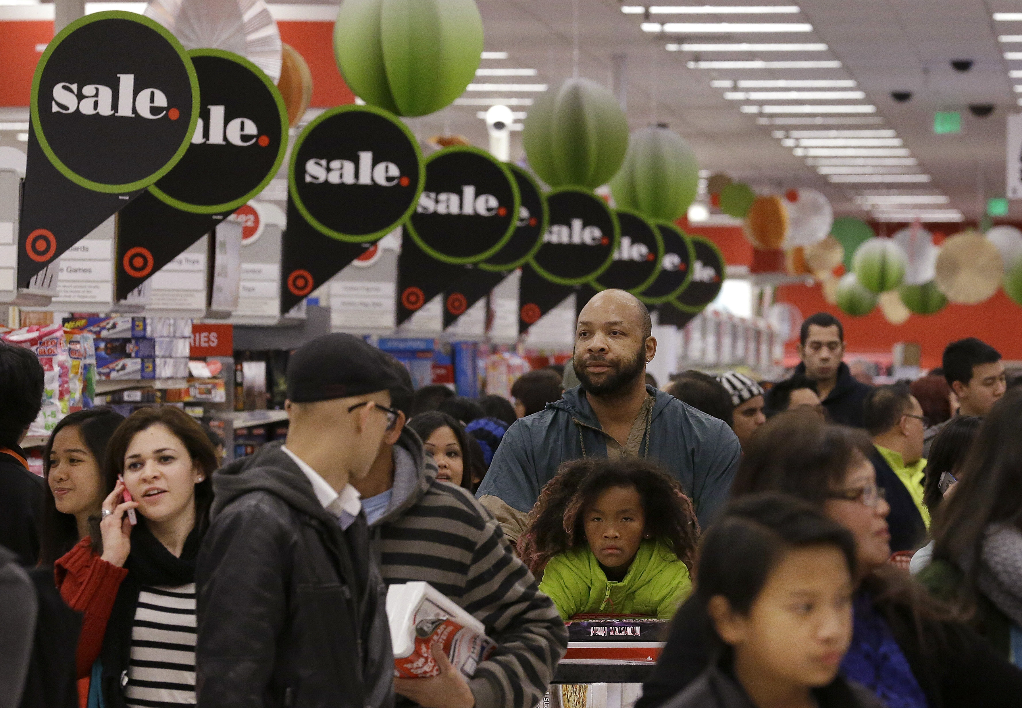 Though more people came out to shop Thanksgiving weekend this year, they spent less money than they did in 2012.