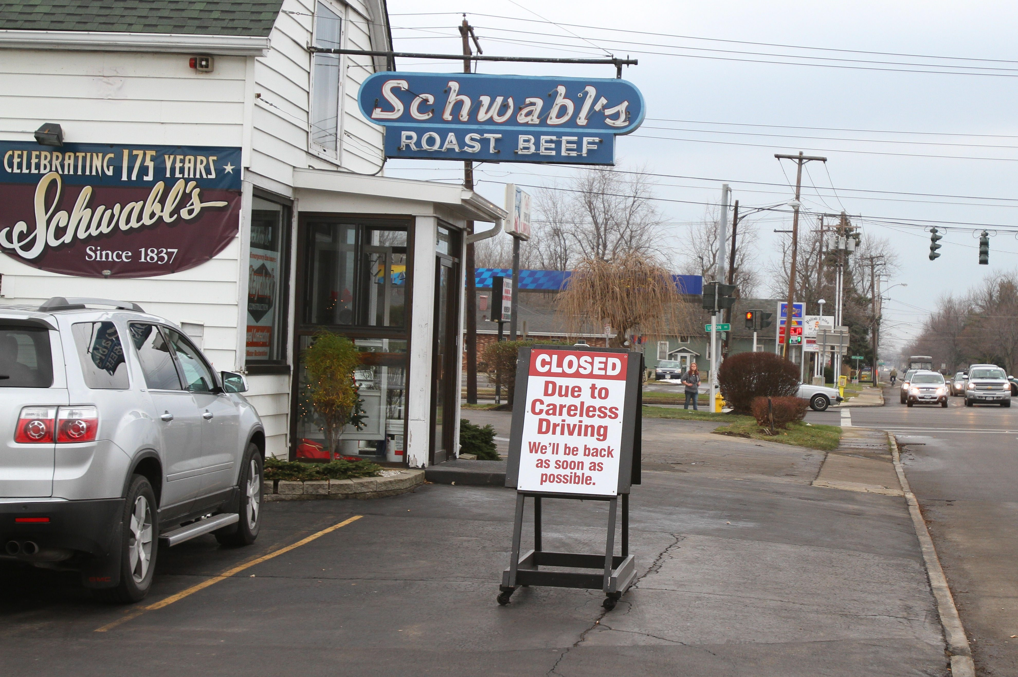 Sign outside of Schwabl's restaurant explains why the restaurant is closed.