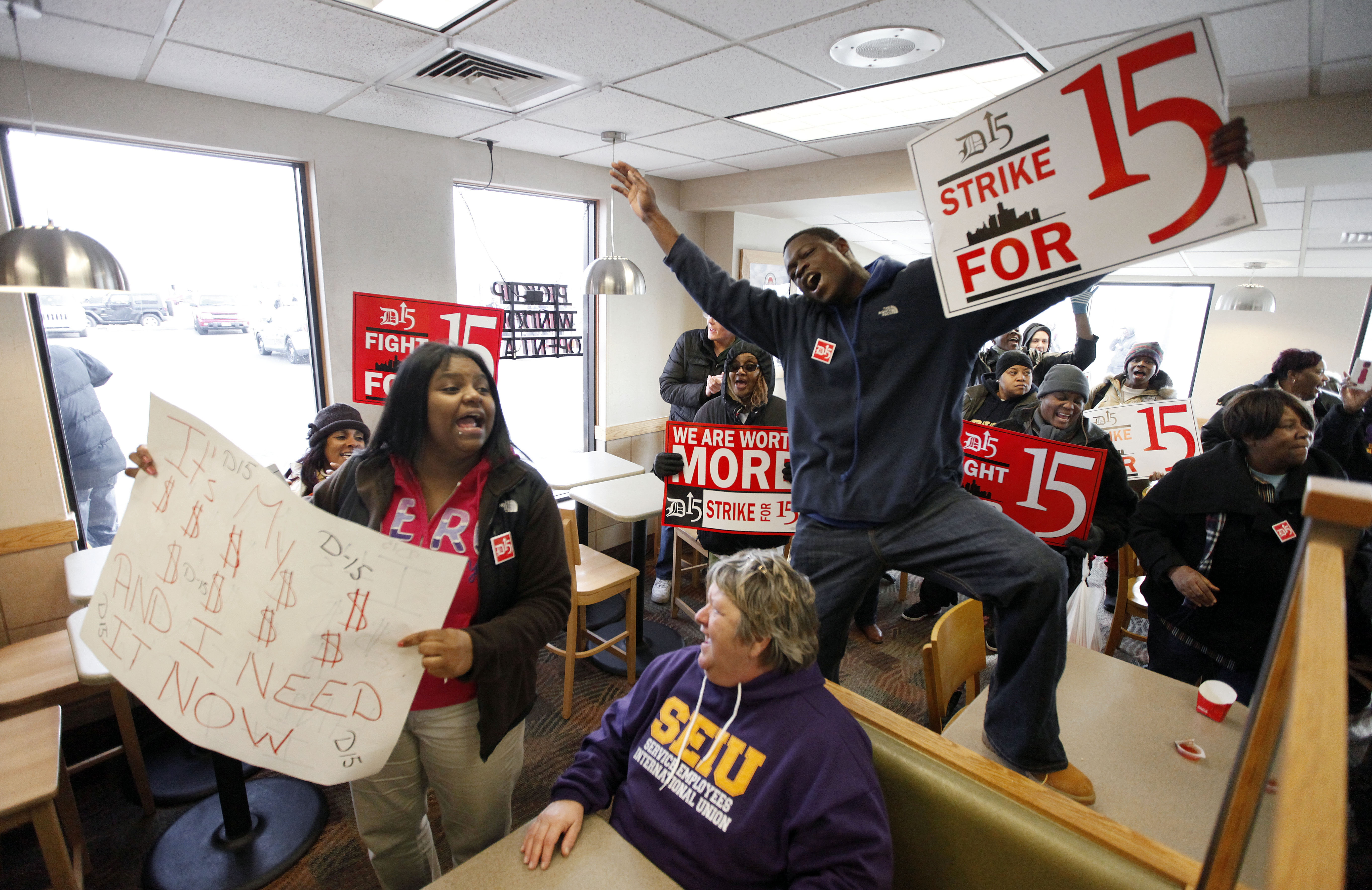 Protesters rally for better wages inside a Wendy's restaurant in Detroit on Thursday. Demonstrations were planned in 100 cities, including Buffalo.