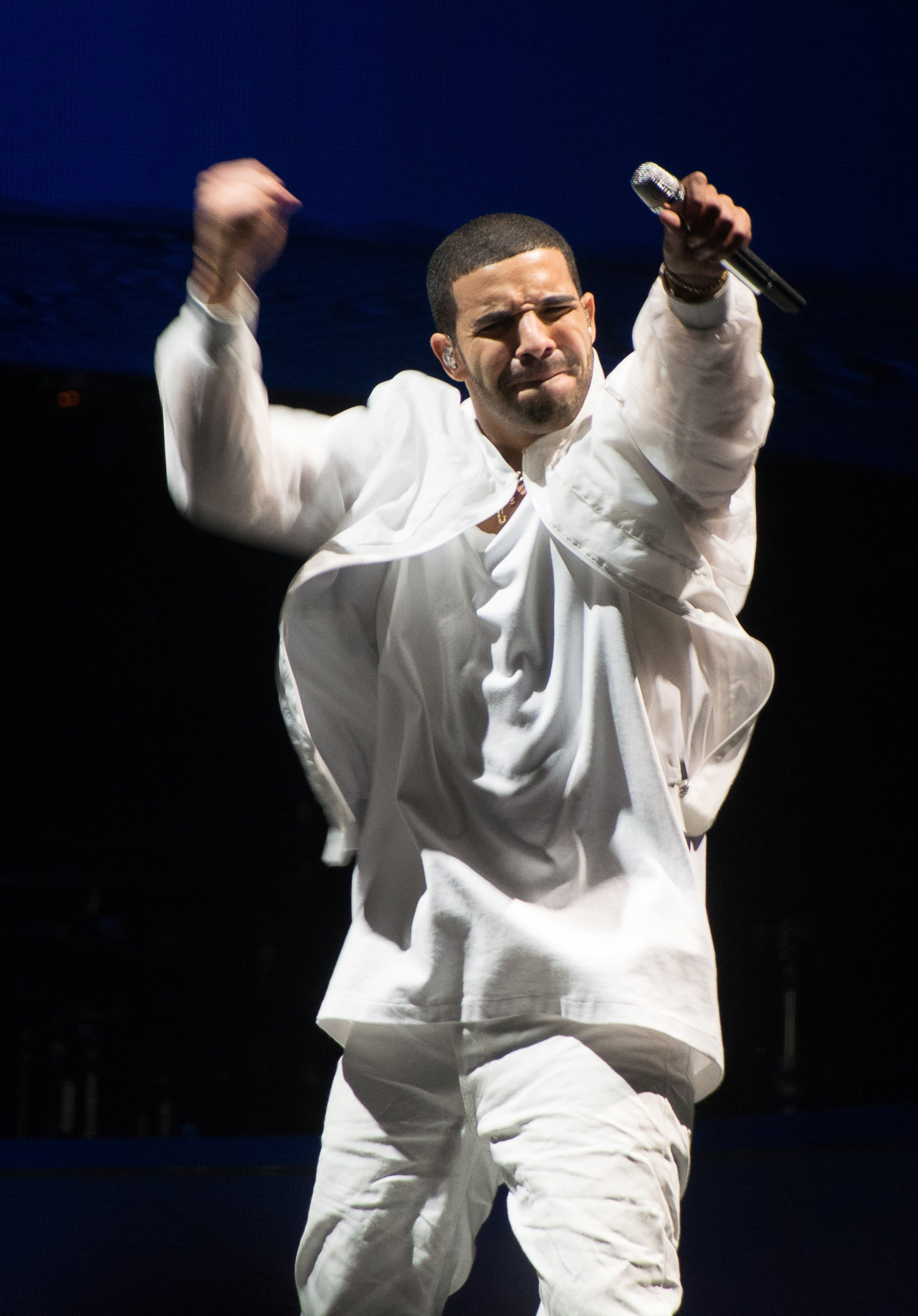 """NEWARK, NJ – OCTOBER 27:  Drake performs at the """"Would You Like A Tour?"""" Concert at Prudential Center on October 27, 2013 in Newark, New Jersey.  (Photo by Dave Kotinsky/Getty Images)"""