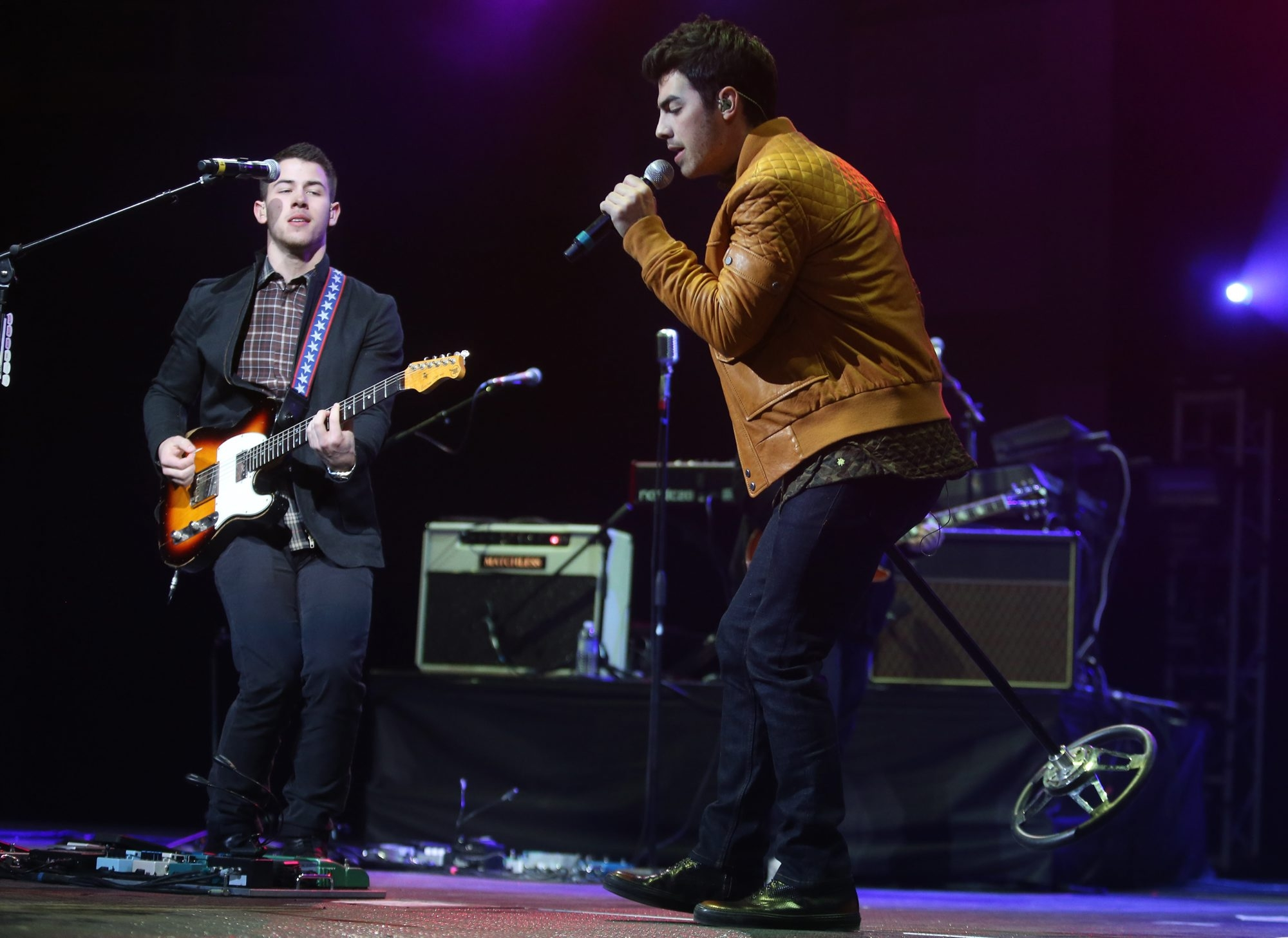 The Jonas Brothers, Nick and Joe, perform onstage at the First Niagara Center in downtown Buffalo, during the annual Kissmas Bash, Thursday, December 12, 2013. (Charles Lewis/Buffalo News)