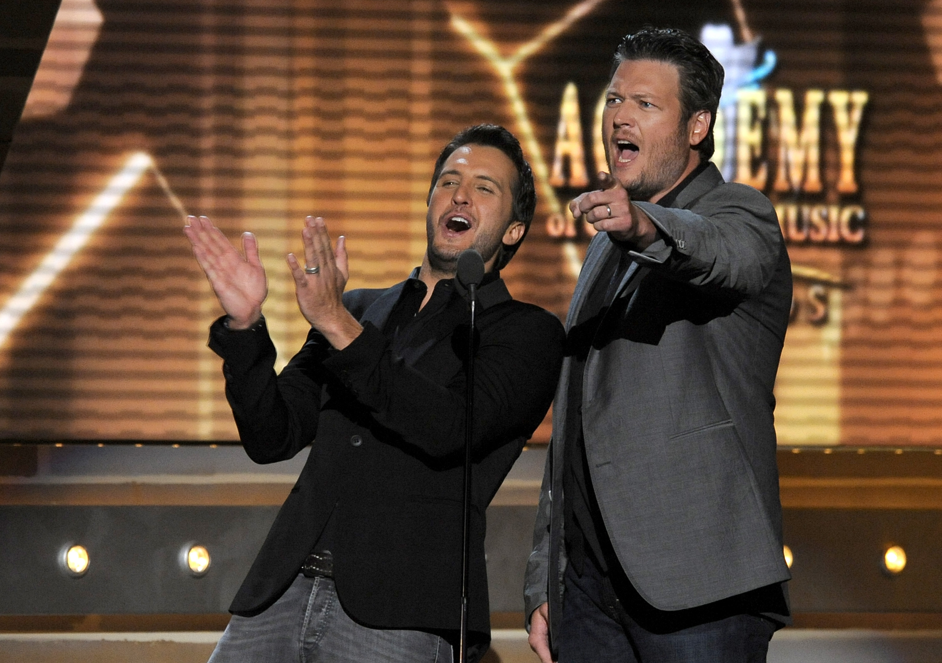 Luke Bryan, left, and Blake Shelton were such a hit at this year's Academy of Country Music Awards that they're coming back as hosts next year.