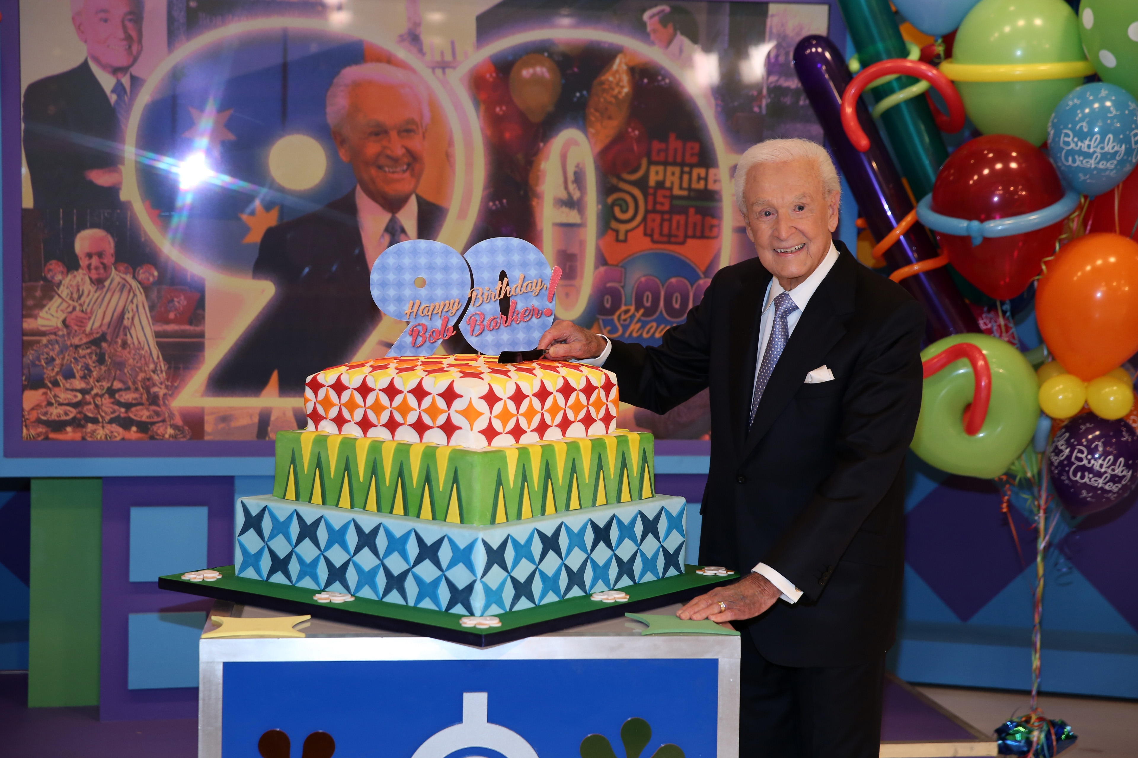 """Veteran game show host Bob Barker, retired, since 2007, was back on the set of """"The Price Is Right"""" for Thursday's show with a cake celebrating his 90th birthday."""