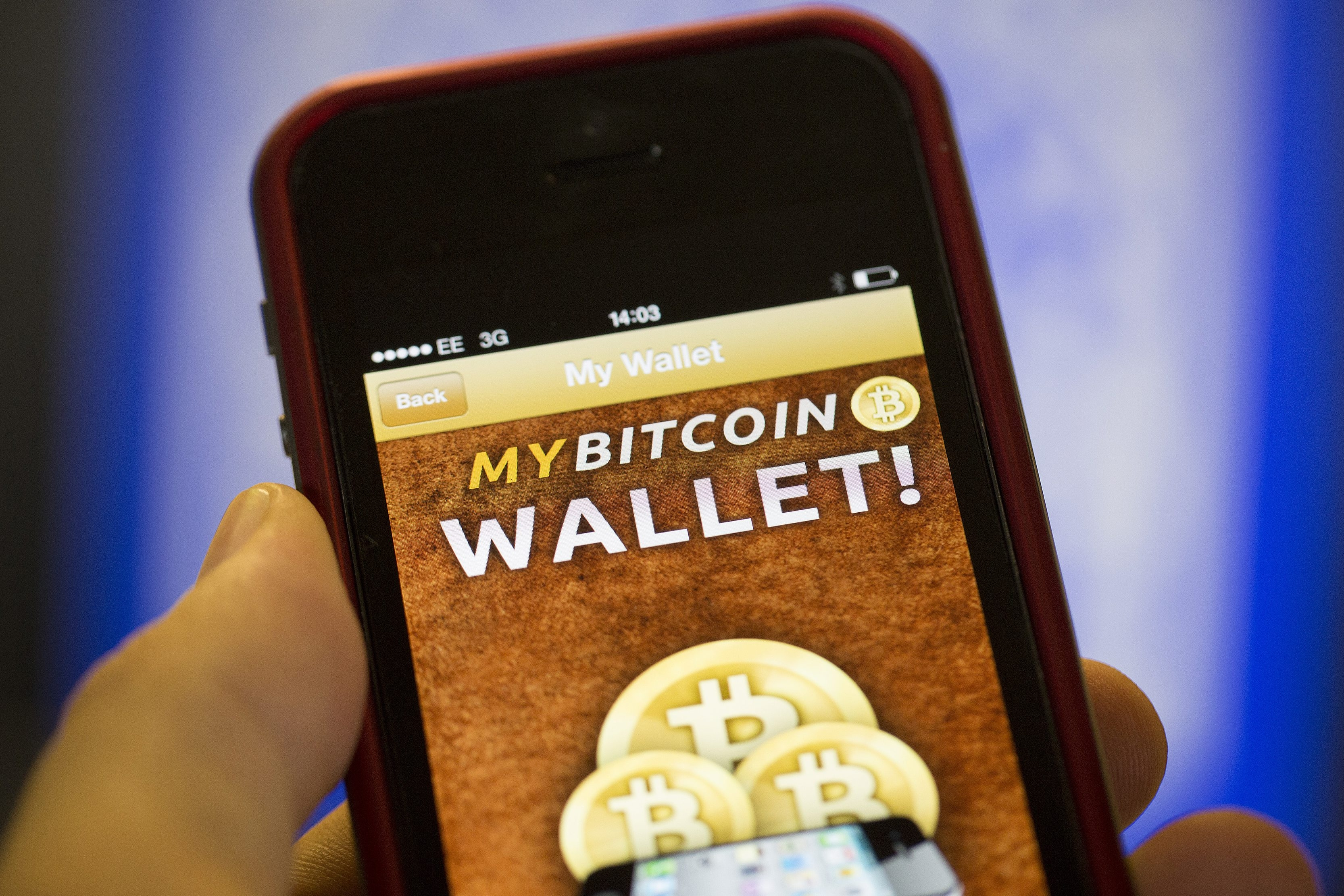 An iPhone displays the Bitcoin Wallet smartphone app. Bitcoins are virtual currency that exist as software and aren't regulated by any country or banking authority.